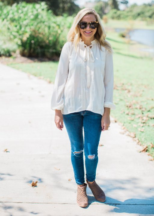tie neck top, jeans and booties
