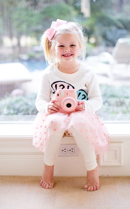 little girls skirt, sweater and leggings