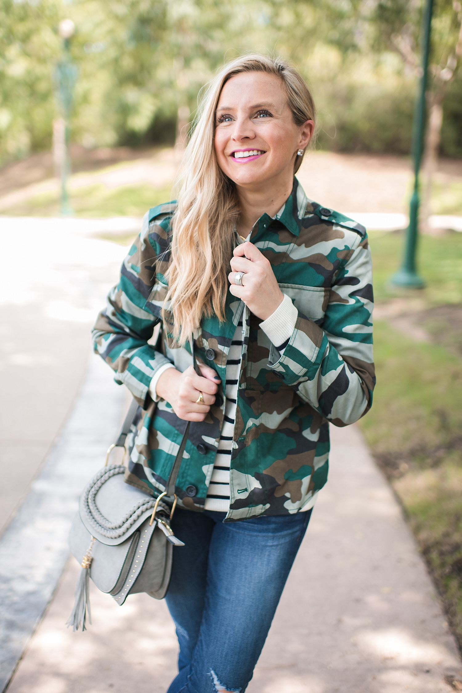 Amazon Fashion Sale: Day of Deals Top Picks featured by top Houston fashion blogger, Fancy Ashley: image of a blonde woman wearing a J.Crew camouflage jacket and grey cross body tassel bag