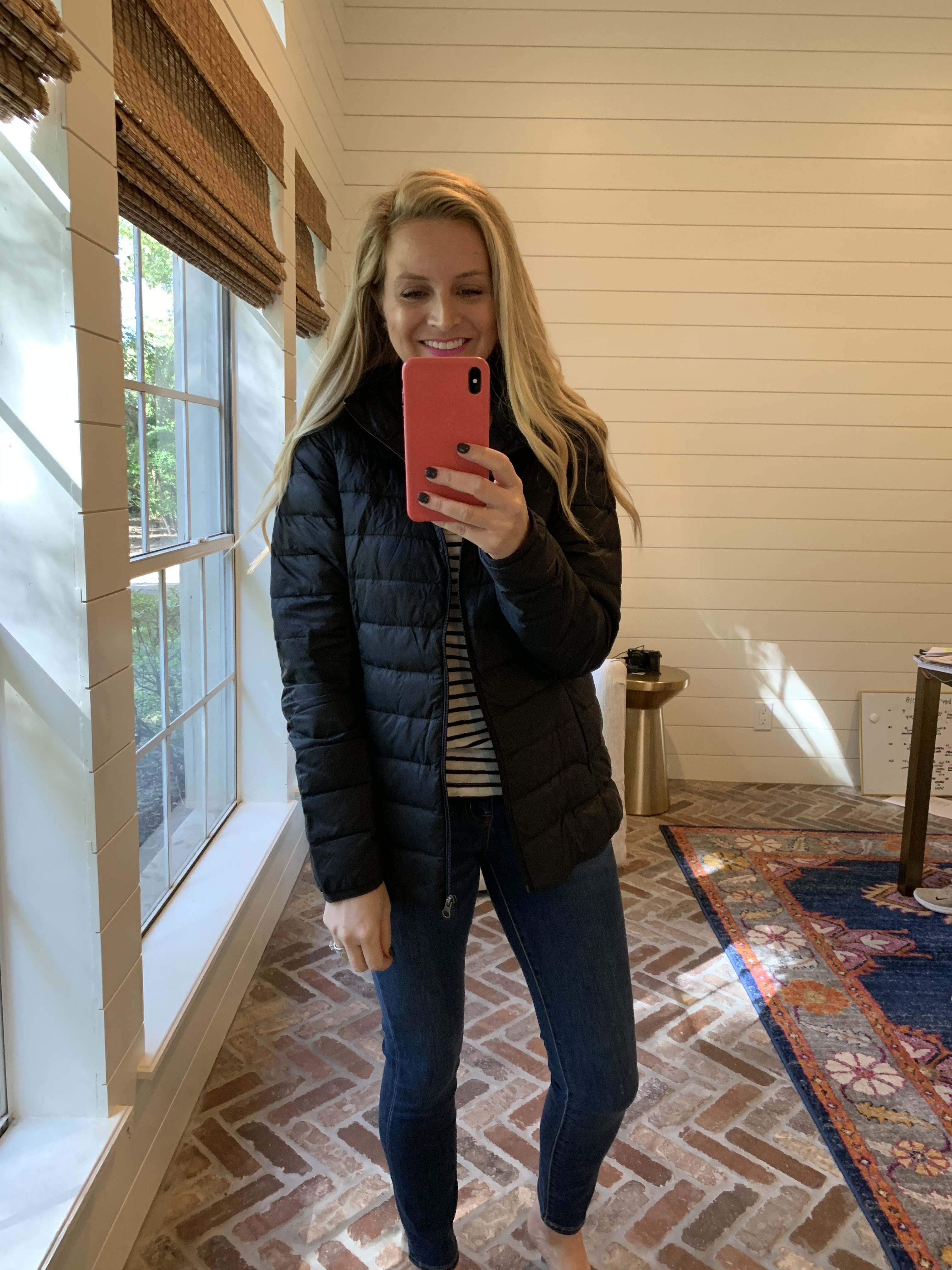 Winter fashion Amazon Favorites featured by top Houston fashion blogger, Fancy Ashley: image of a woman wearing an Amazon Essentials lightweight puffer jacket