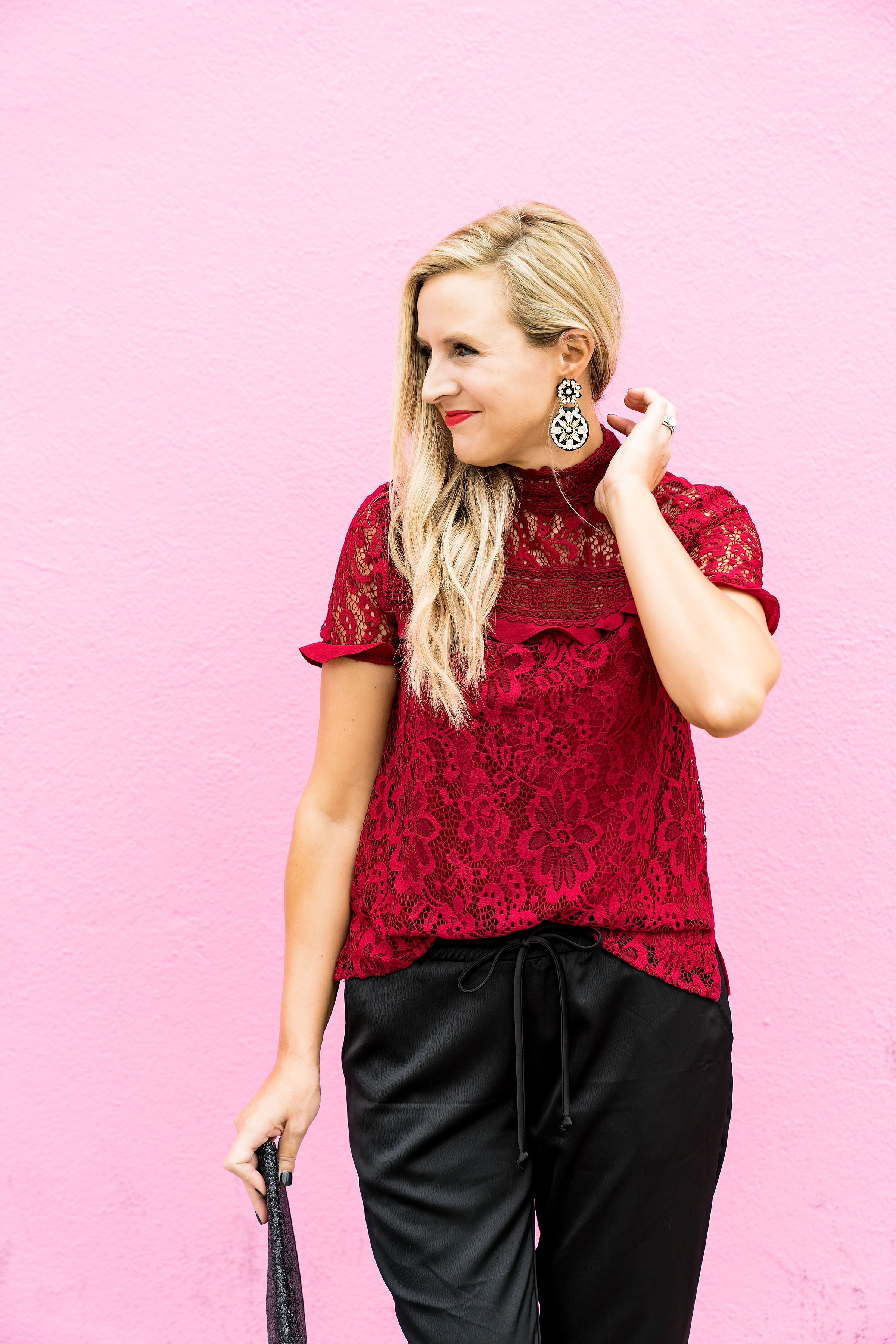Gibson x Glam Collection Outfits featured by top Houston fashion blog, Fancy Ashley: a blonde woman walking wearing red lace top, silk joggers, leopard heels and black clutch