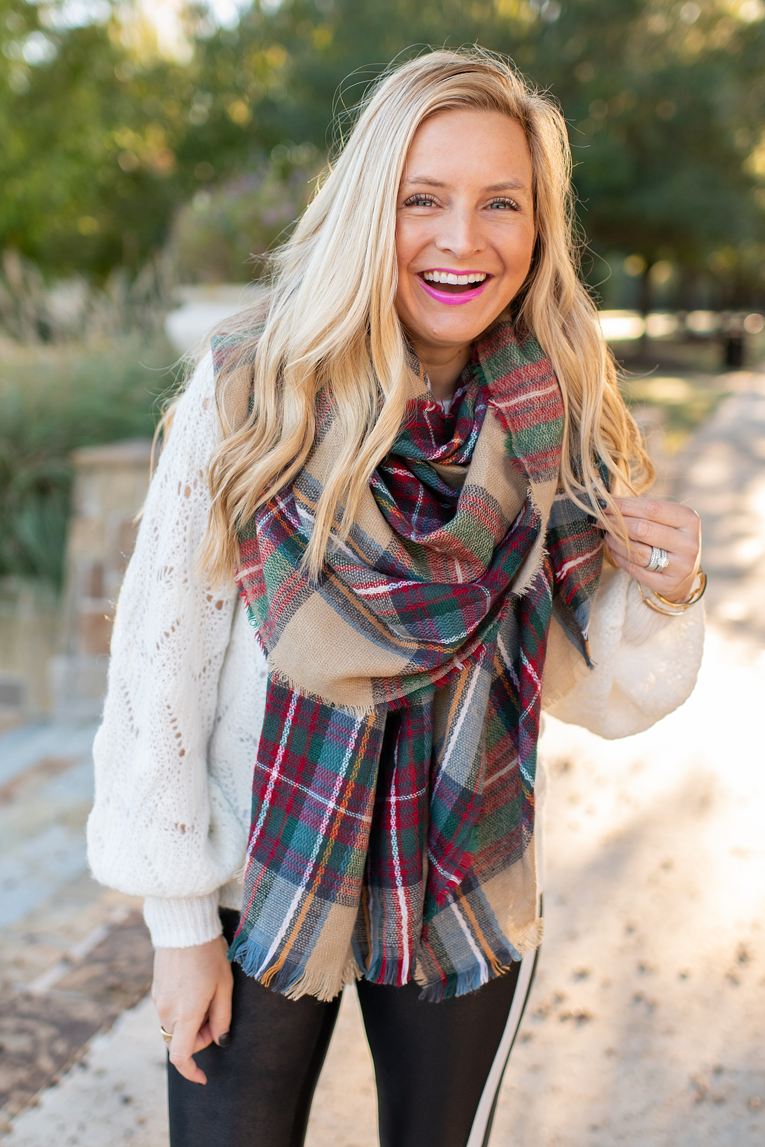 Winter fashion Amazon Favorites featured by top Houston fashion blogger, Fancy Ashley: image of a woman wearing a balloon sleeve sweater, plaid shawl scarf, gold and leopard sneakers, shoulder tote bag and SPANX faux leather leggings