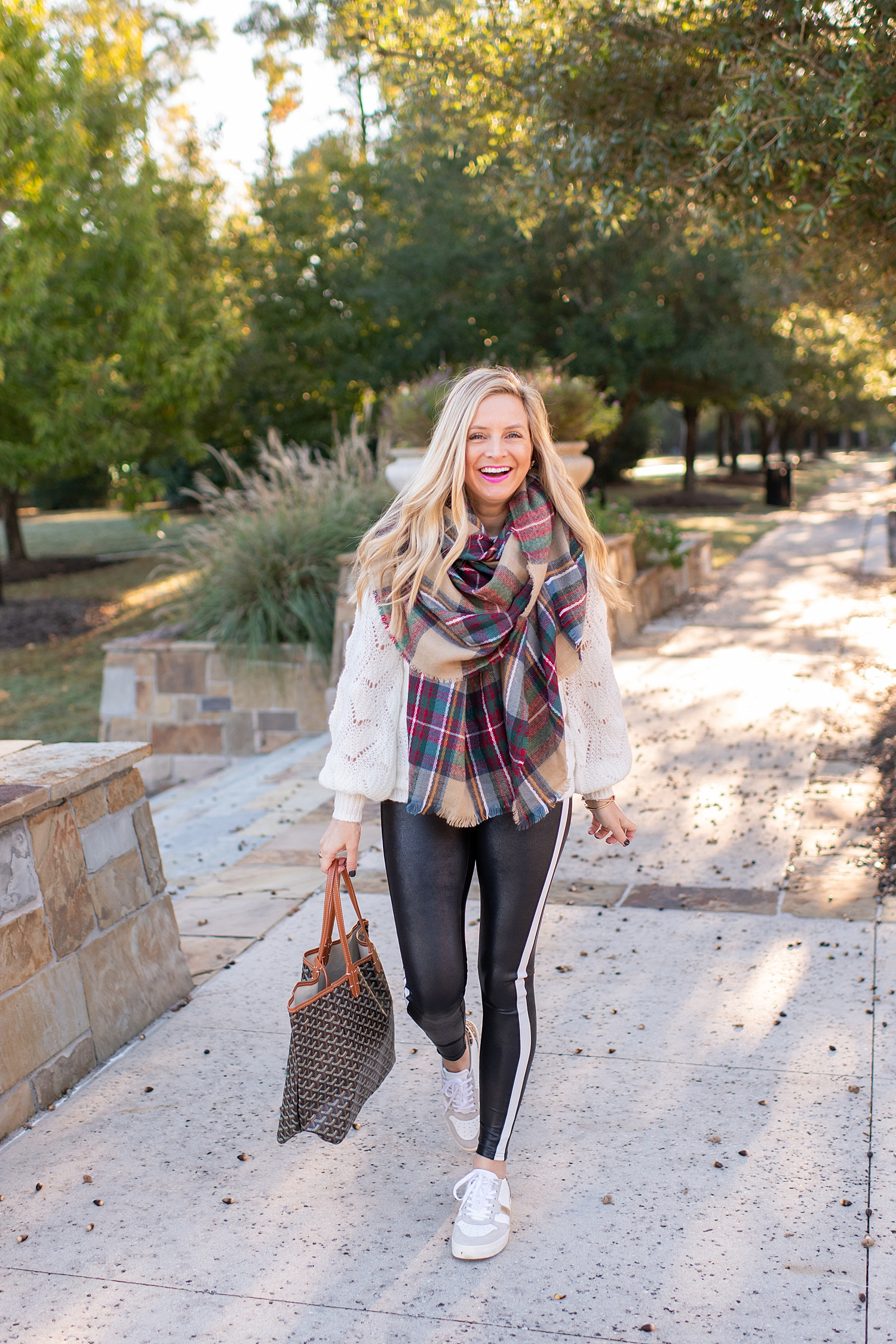 The Ultimate Cyber Monday Shopping Deals featured by top Houston life and style blogger, Fancy Ashley: picture of a woman wearing SPANX faux leather leggings, plaid scarf, metallic leopard sneakers, tote bag, Halogen sweater