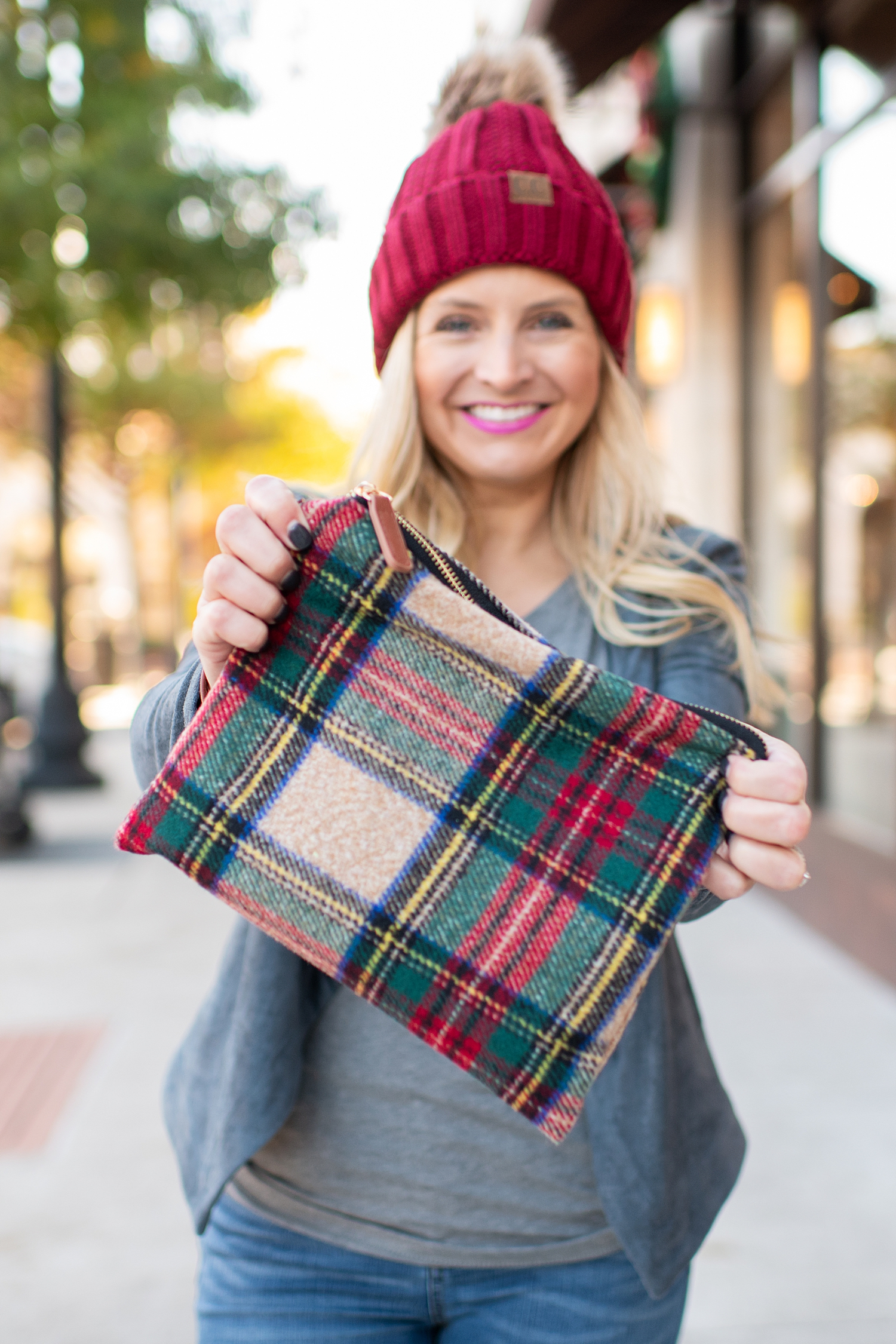 Fancy Ashley x Social Threads collection featured by top Houston fashion blogger, Fancy Ashley: image of a Social Threads plaid clutch
