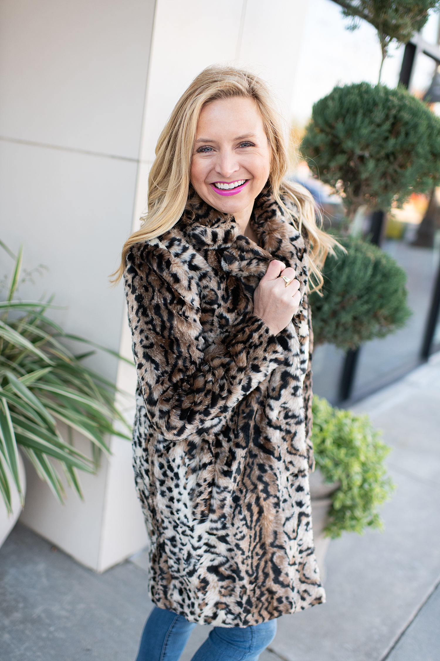 Fancy Ashley x Social Threads collection featured by top Houston fashion blogger, Fancy Ashley: image of a woman wearing a Social Threads leopard faux fur coat, Social Threads skinny jeans, and Golden Goose sneakers