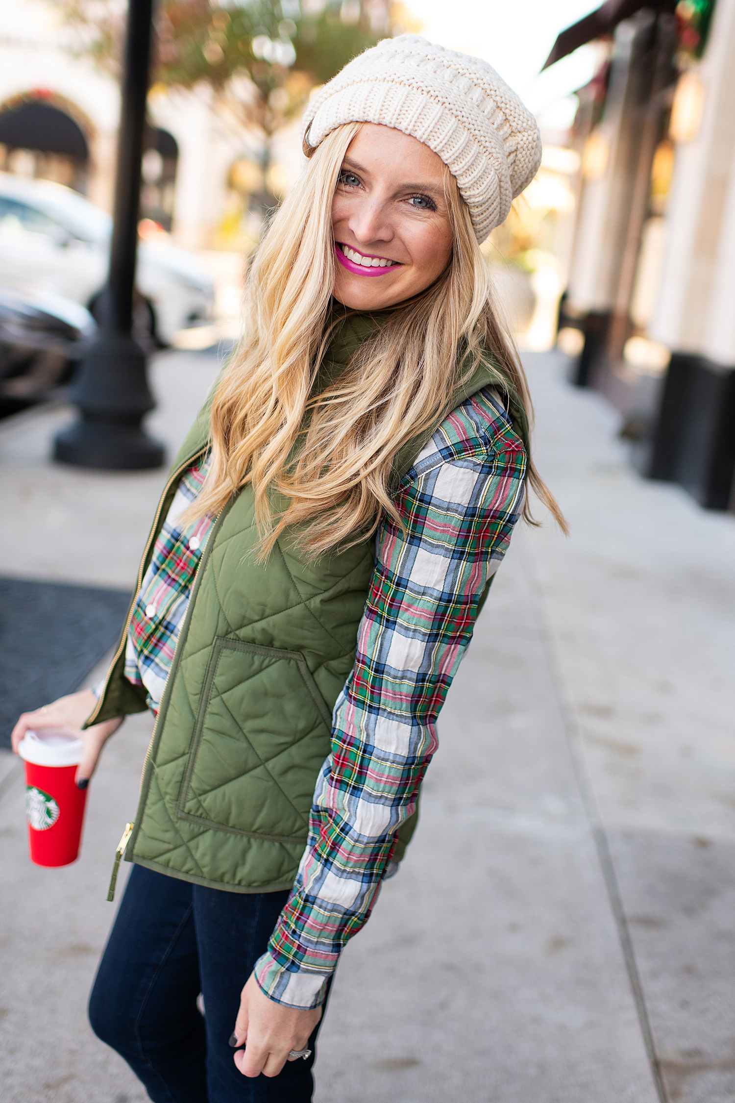 Winter fashion Amazon Favorites featured by top Houston fashion blogger, Fancy Ashley: image of a woman wearing a J.Crew tartan shirt, J.Crew puffer vest, Nordstrom high waist ankle jeans, pom pom beanie and Sole Society bootie