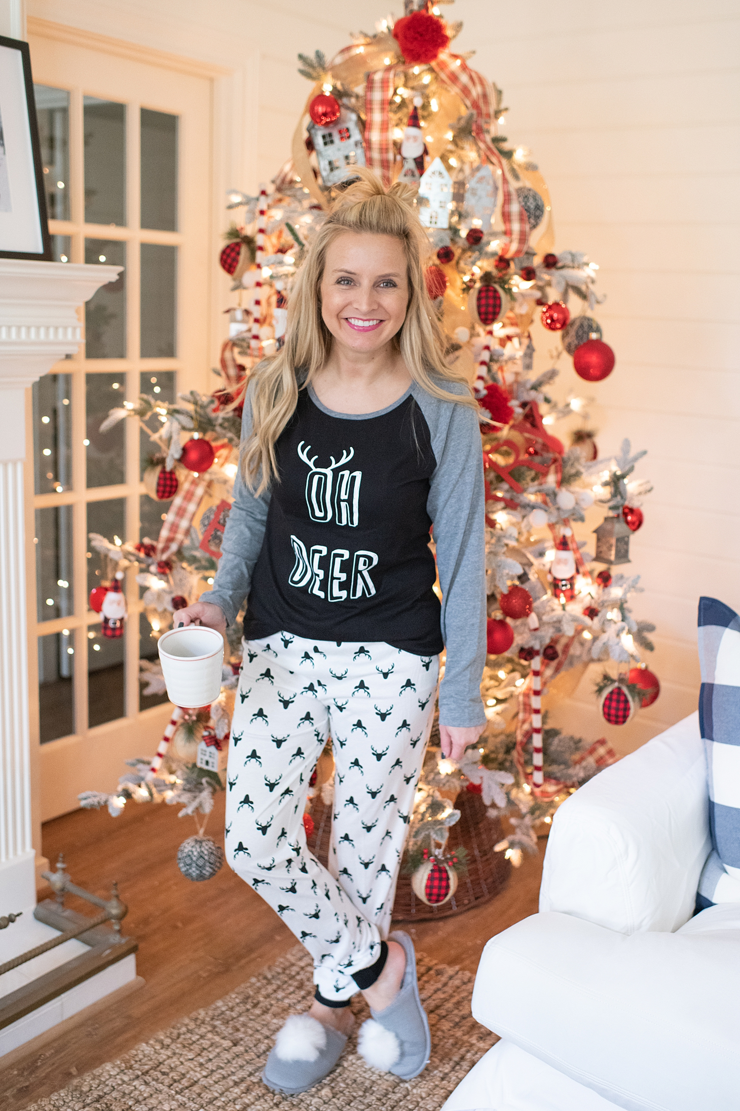 "Holiday Pjs & Top Macy's Christmas Gifts featured by top Houston life and style blog, Fancy Ashley"" image of a woman wearing Holiday pjs and grey slippers available at Macy's"