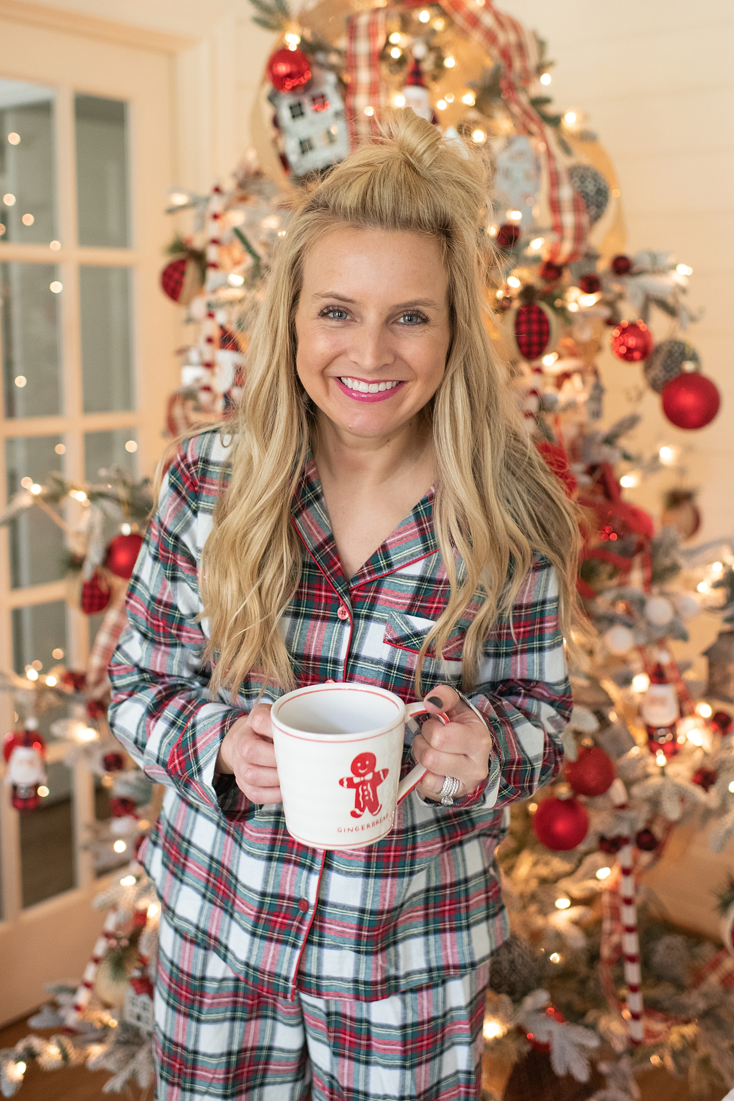 "Holiday Pjs & Top Macy's Christmas Gifts featured by top Houston life and style blog, Fancy Ashley"" image of a woman wearing plaid Holiday pjs and grey slippers available at Macy's"