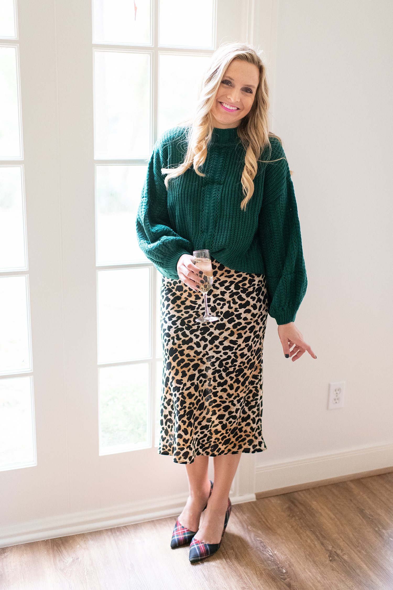 The Ultimate Cyber Monday Shopping Deals featured by top Houston life and style blogger, Fancy Ashley: picture of a woman wearing a Social Threads green cozy sweater, leopard skirt and plaid heels