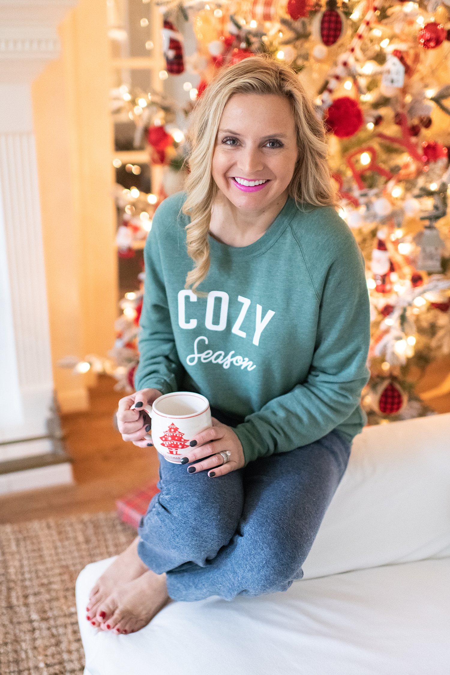Fancy Ashley x Social Threads collection featured by top Houston fashion blogger, Fancy Ashley: image of a woman wearing a Social Threads cozy sweatshirt and Social Threads navy sweatpants
