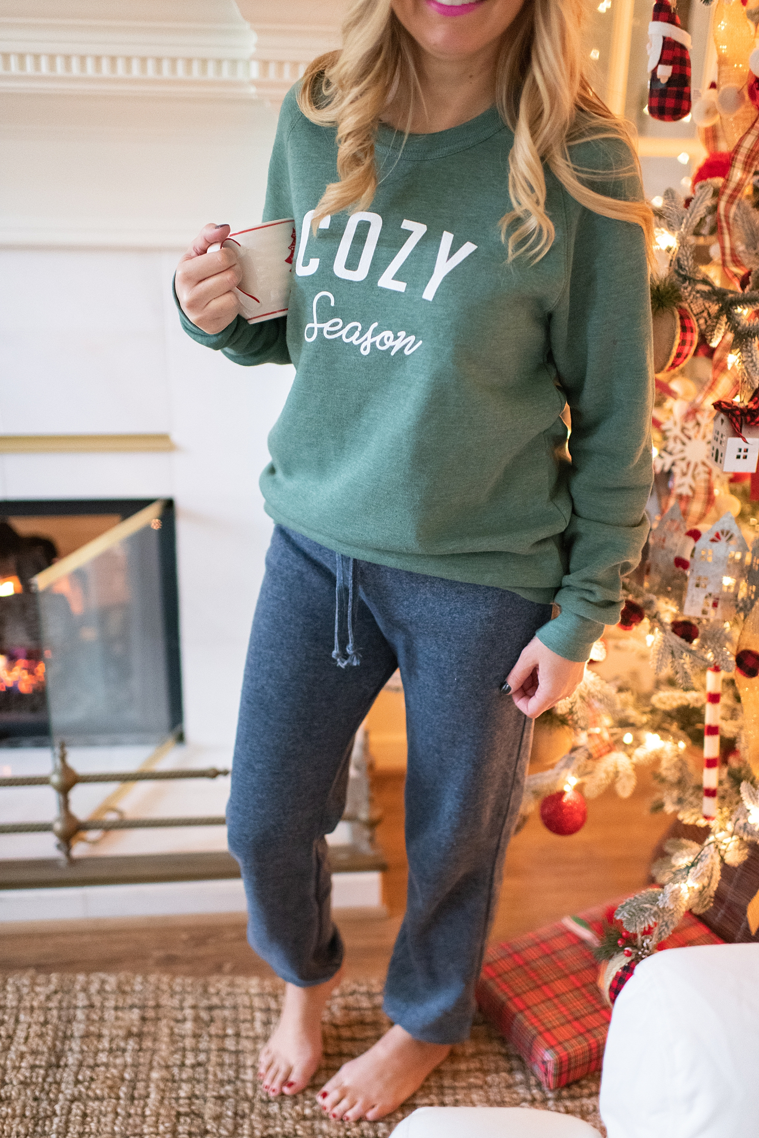 The Ultimate Cyber Monday Shopping Deals featured by top Houston life and style blogger, Fancy Ashley: picture of a woman wearing a Social Threads green cozy sweater and grey sweat pants
