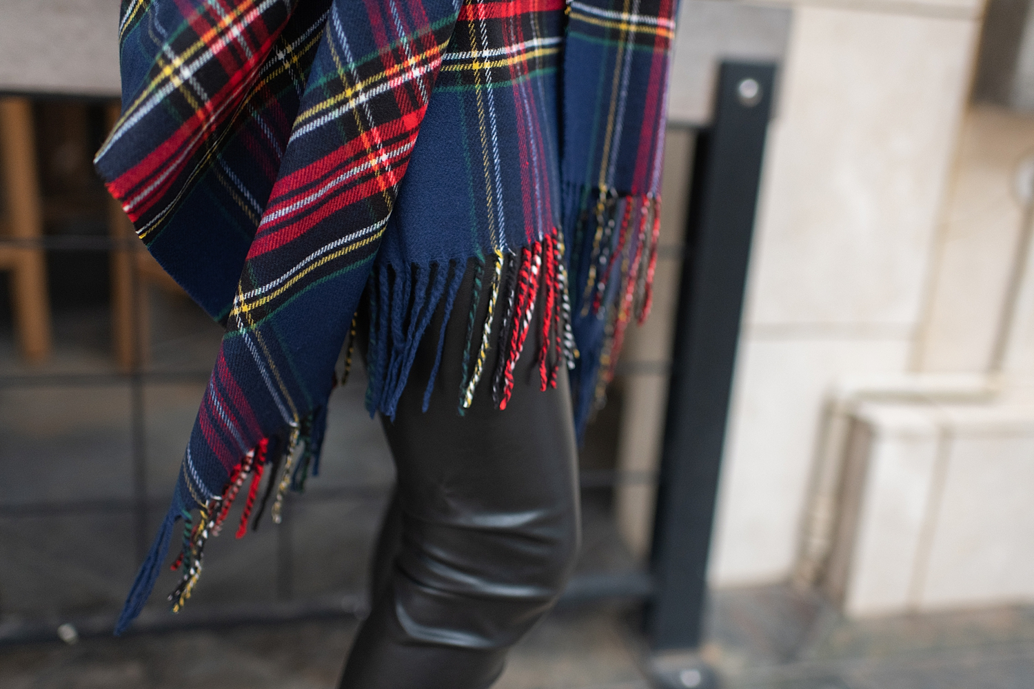 Fancy Ashley x Social Threads collection featured by top Houston fashion blogger, Fancy Ashley: image of a woman wearing a Social Threads plaid vest, Social Threads faux leather leggings, black turtleneck, Social Threads quilted clutch and Sole Society booties