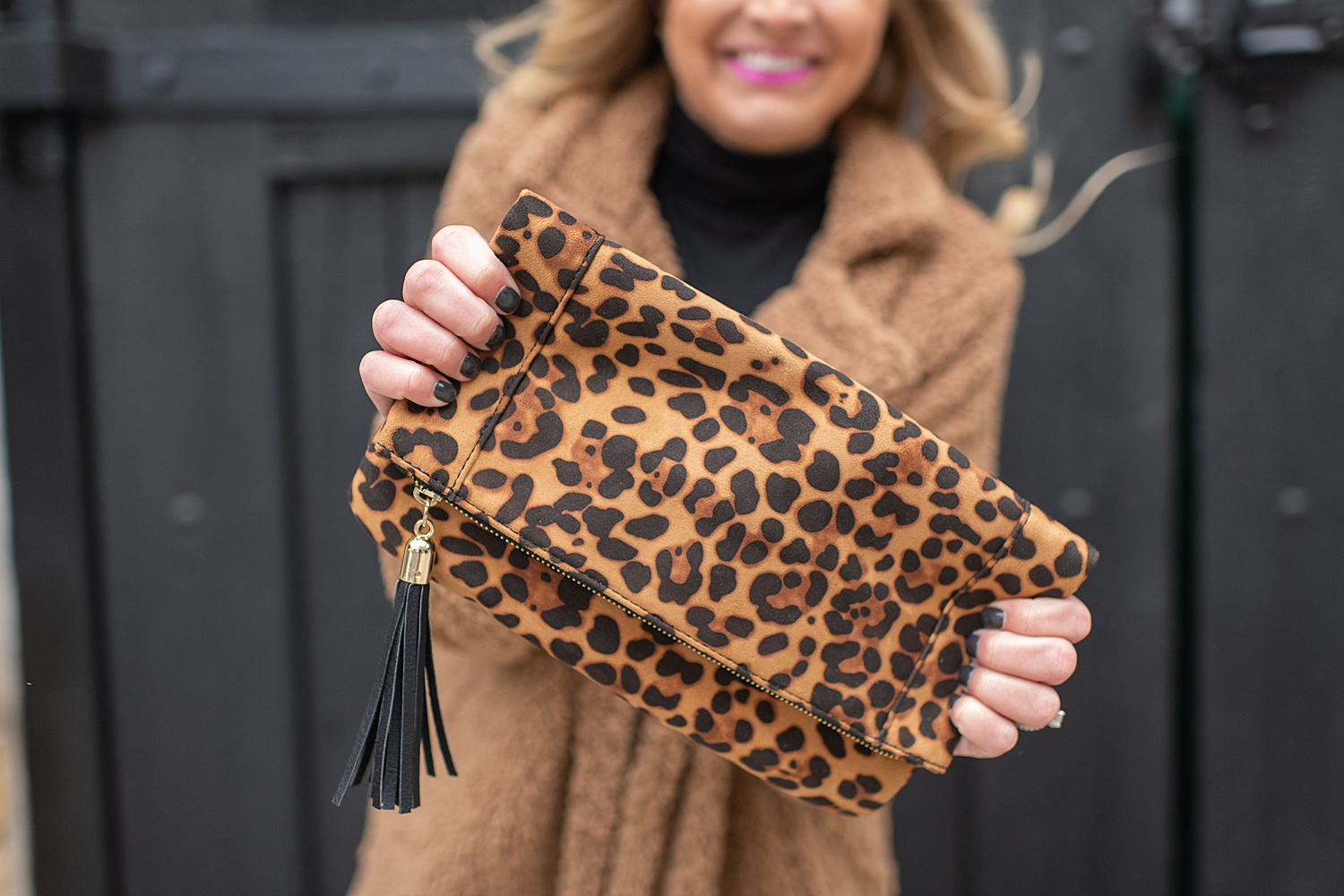 Fashion Accessories Gift Ideas with Sole Society featured by top Houston fashion blogger, Fancy Ashley: image of a woman wearing a Faux fur coat, Sole Society booties, Sole Society leopard clutch, Social Threads faux leather leggings and Social Threads black turtleneck