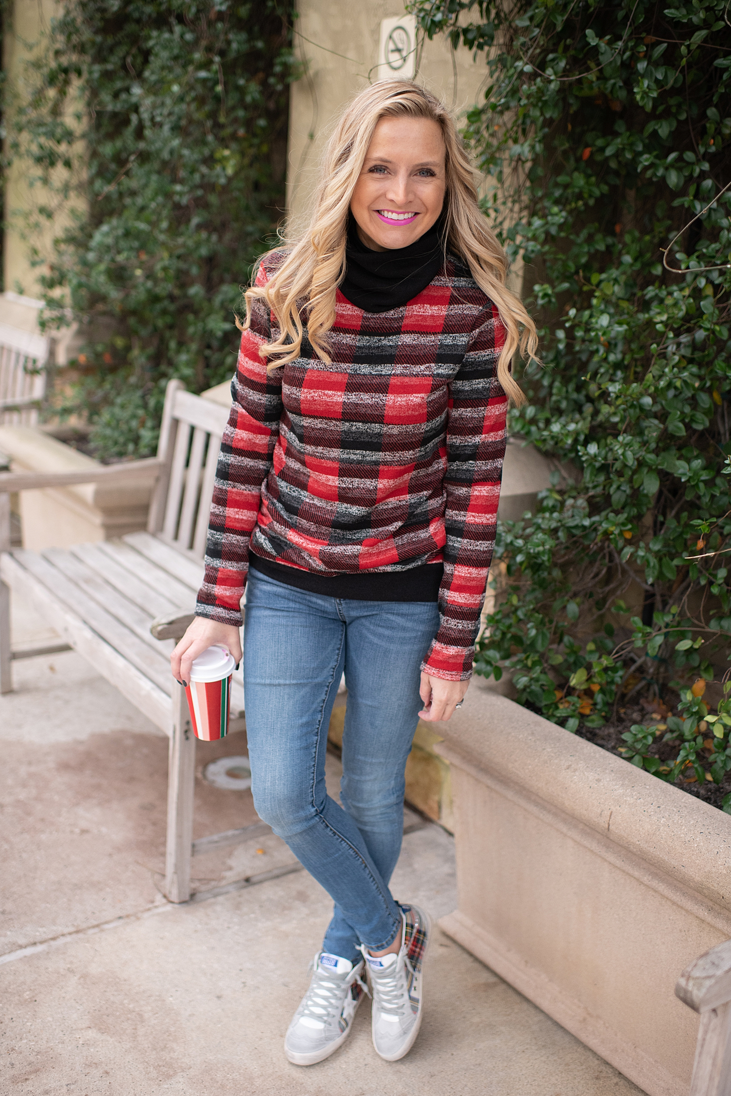Fancy Ashley x Social Threads collection featured by top Houston fashion blogger, Fancy Ashley: image of a woman wearing a Social Threads plaid turtleneck, Social Threads skinny jeans and Golden Goose sneakers