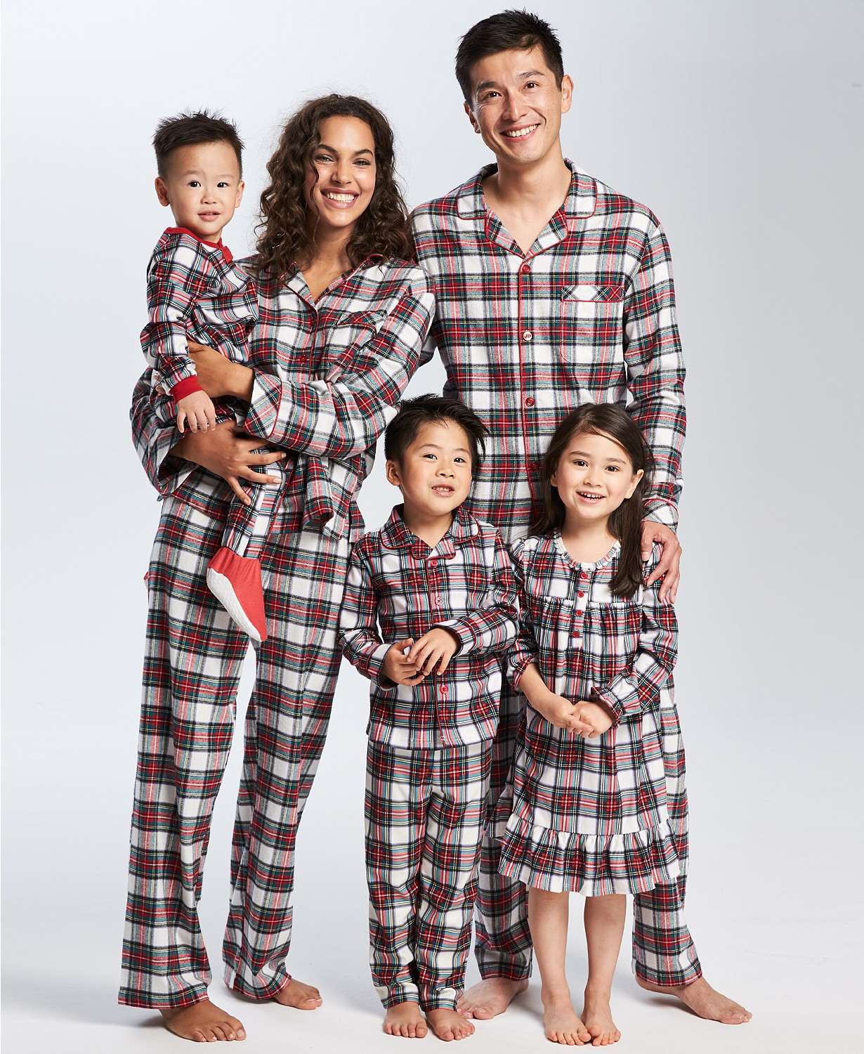 "Holiday Pjs & Top Macy's Christmas Gifts featured by top Houston life and style blog, Fancy Ashley"" image of a family wearing plaid holiday pjs available at Macy's"