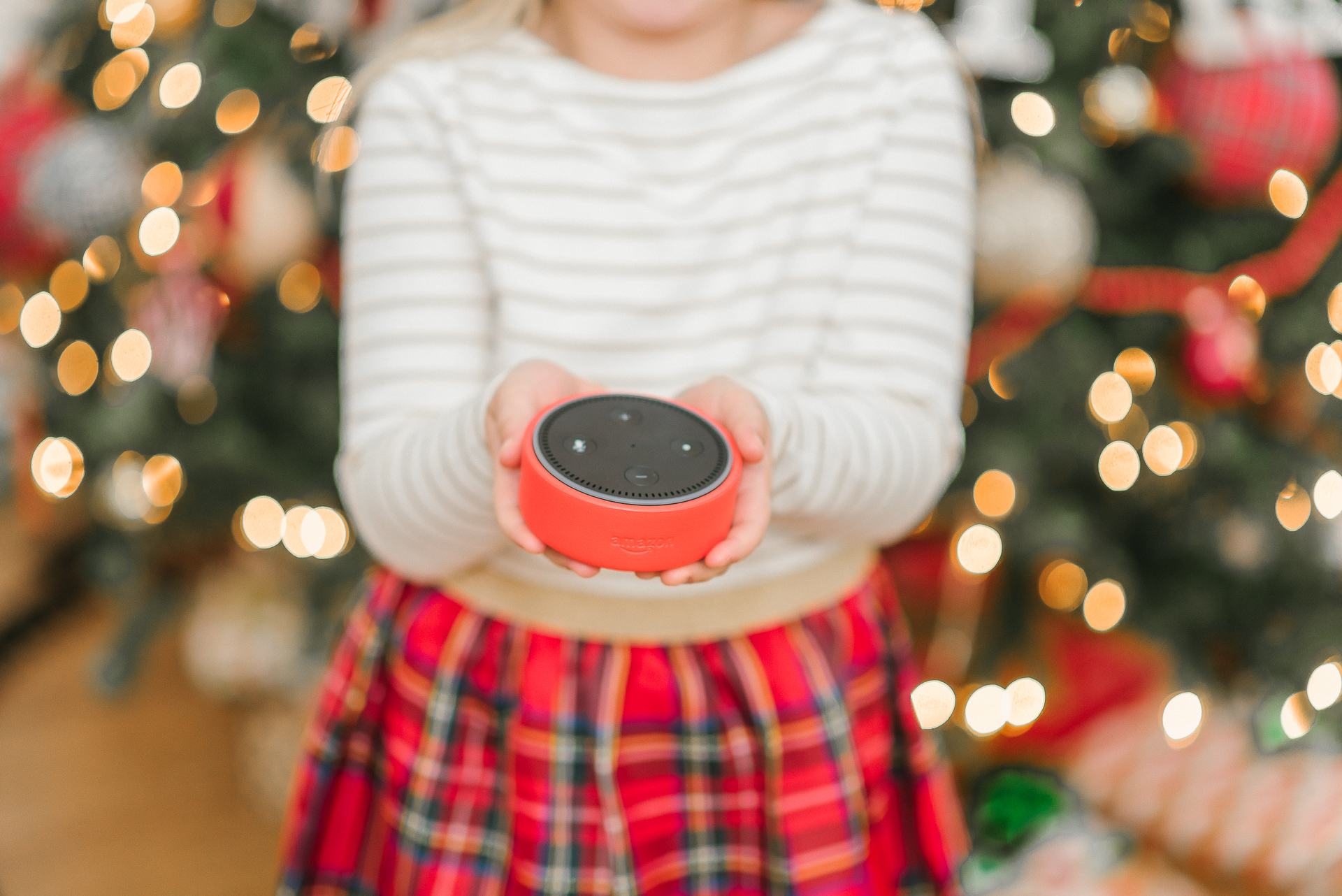 Echo Dot Kids Edition review featured by top Houston lifestyle blogger, Fancy Ashley: image of a girl holding a red Amazon Echo Kids Edition