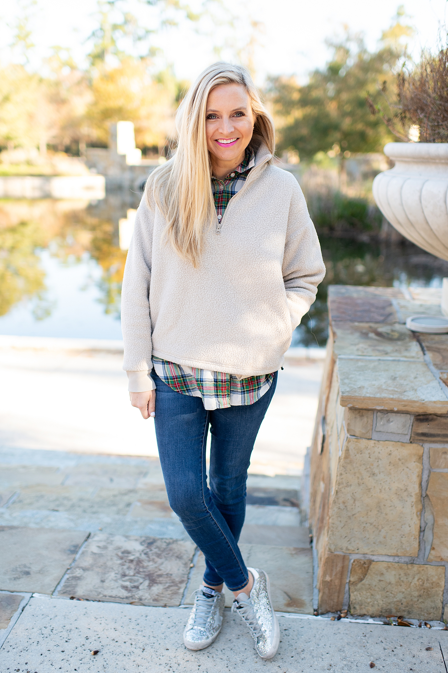 The Best Cozy Gift Ideas featured by top Houston fashion blogger, Fancy Ashley: picture of a blonde woman wearing an Everlane zip fleece, J.Crew tartan shirt, J.Crew skinny jeans and Golden Goose sneakers