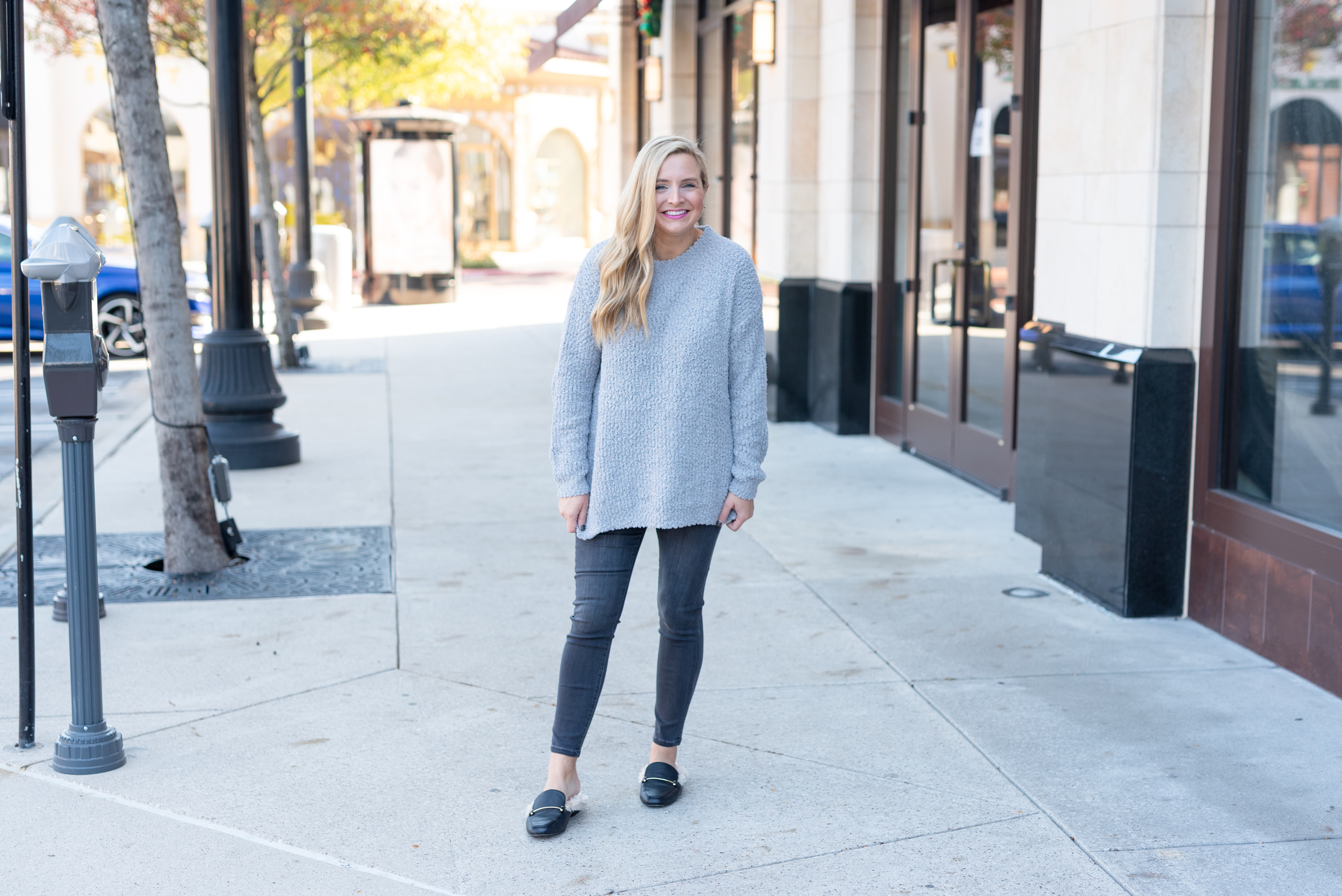 Amazon Haul by popular Houston fashion blog, Fancy Ashley: image of a woman wearing a Amazon Ybenlow Womens Fuzzy Sweater, Amazon Liverpool Women's Sienna Pull-on Ankle Silky Soft Denim Jeans, and Target Women's Rebe Faux Fur Mules.