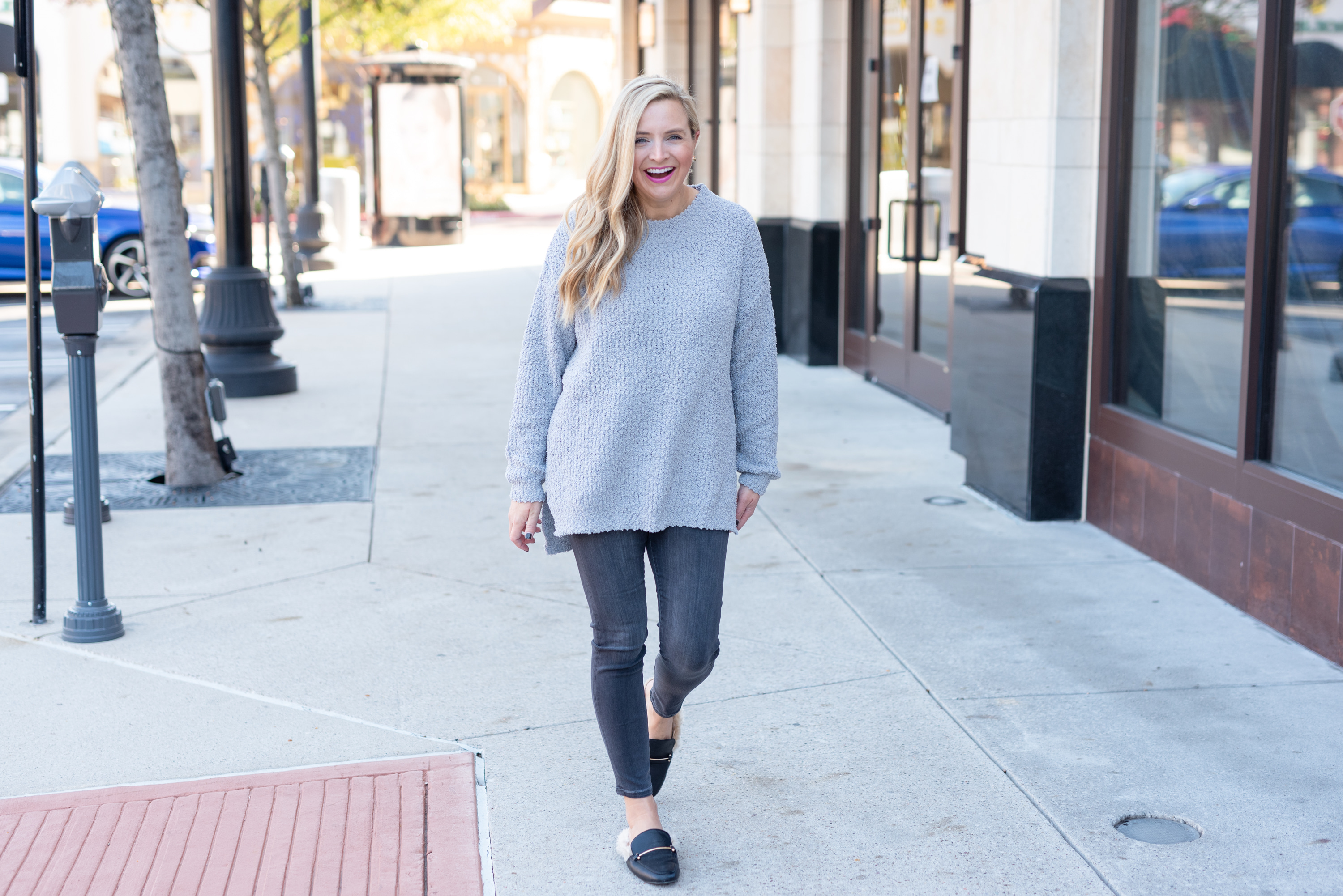 Best Sweaters on Amazon by popular Houston fashion blog, Fancy Ashley: image of a woman wearing a Amazon sweater, black jeans, and black faux fur lined mules.