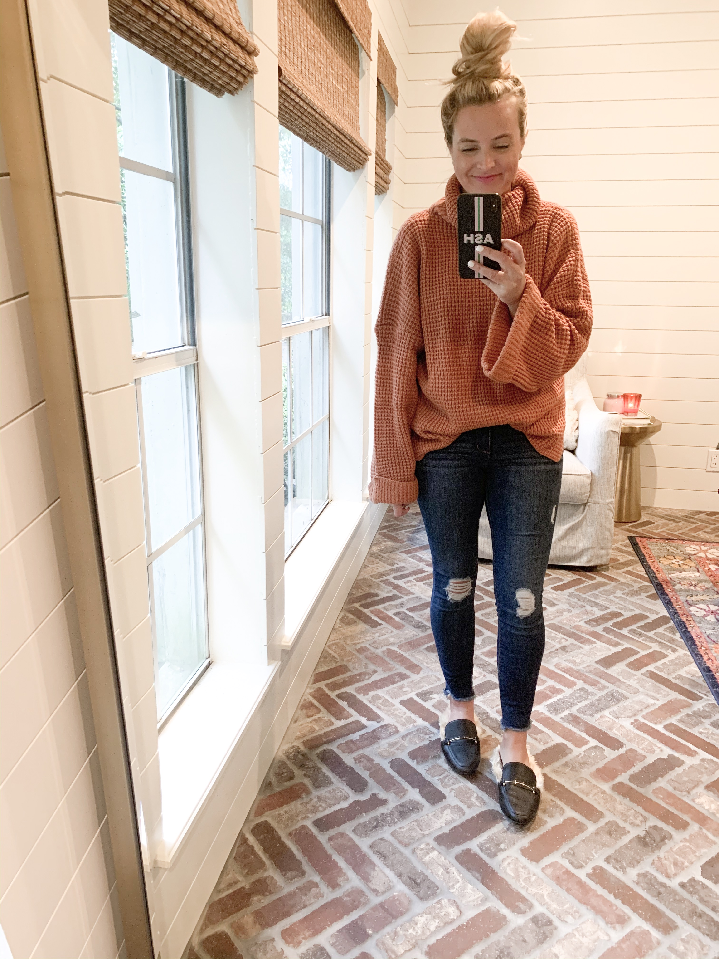Amazon Haul by popular Houston fashion blog, Fancy Ashley: image of a woman wearing a Amazon Ybenlow Womens Turtleneck Oversized Sweater, Walmart Sofia Jeans by Sofia Vergara Women's Skinny Destructed Mid-Rise Ankle Jeans, and Target Women's Rebe Faux Fur Mules