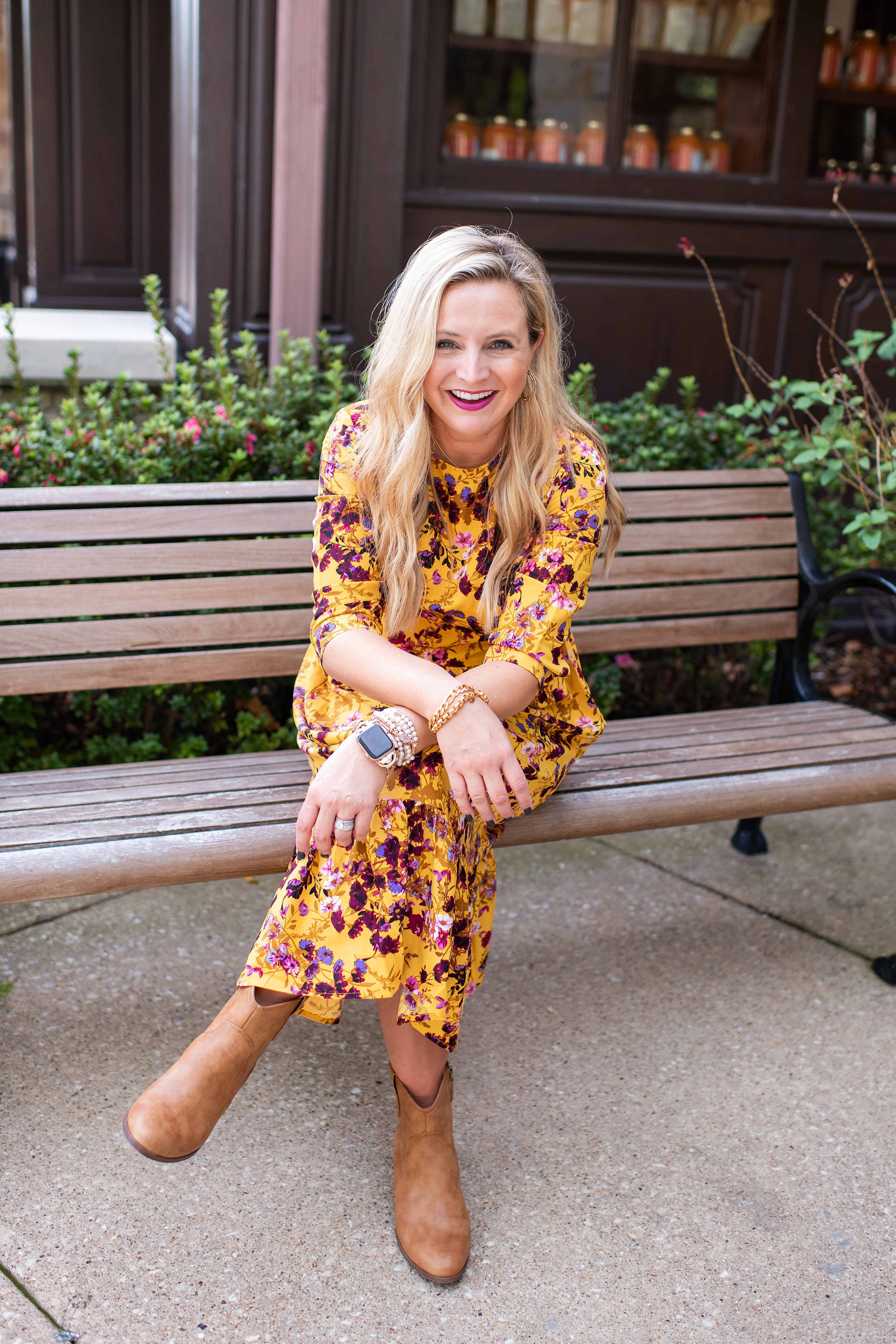 Cute Fall Outfits by popular Houston fashion blog, Fancy Ashley: image of a woman wearing a yellow and pink floral maxi dress and tan ankle boots.
