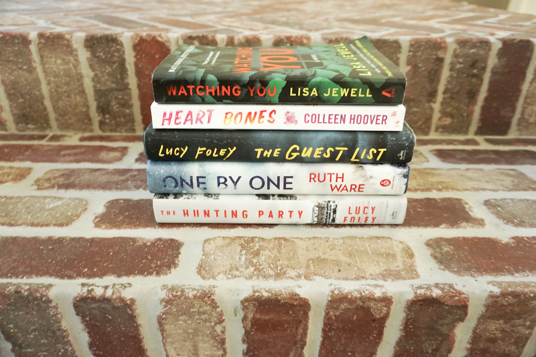 Book Review by popular Houston lifestyle blog, Fancy Ashley: image of the books Watching You, Heart Bones, The Guest List, One By One, and The Hunting Party.