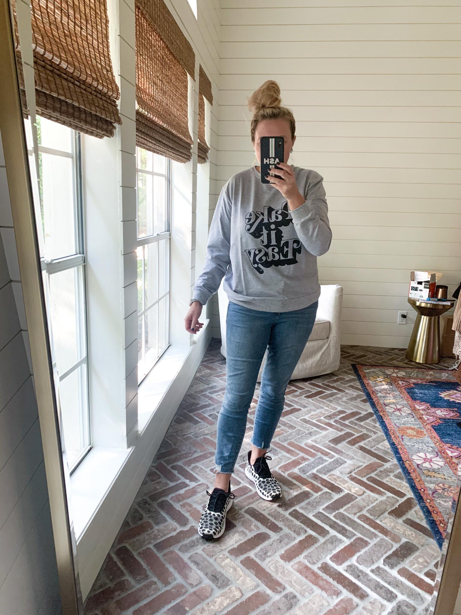 Amazon Haul by popular Houston fashion blog, Fancy Ashley: image of a woman wearing a Amazon SUUKSESS Women Sweatshirt, Walmart Sofia Jeans Rosa Curvy Ripped Hem High Waist Ankle Jean, and Walmart Women's Athletic Works Soft Running Sneaker.