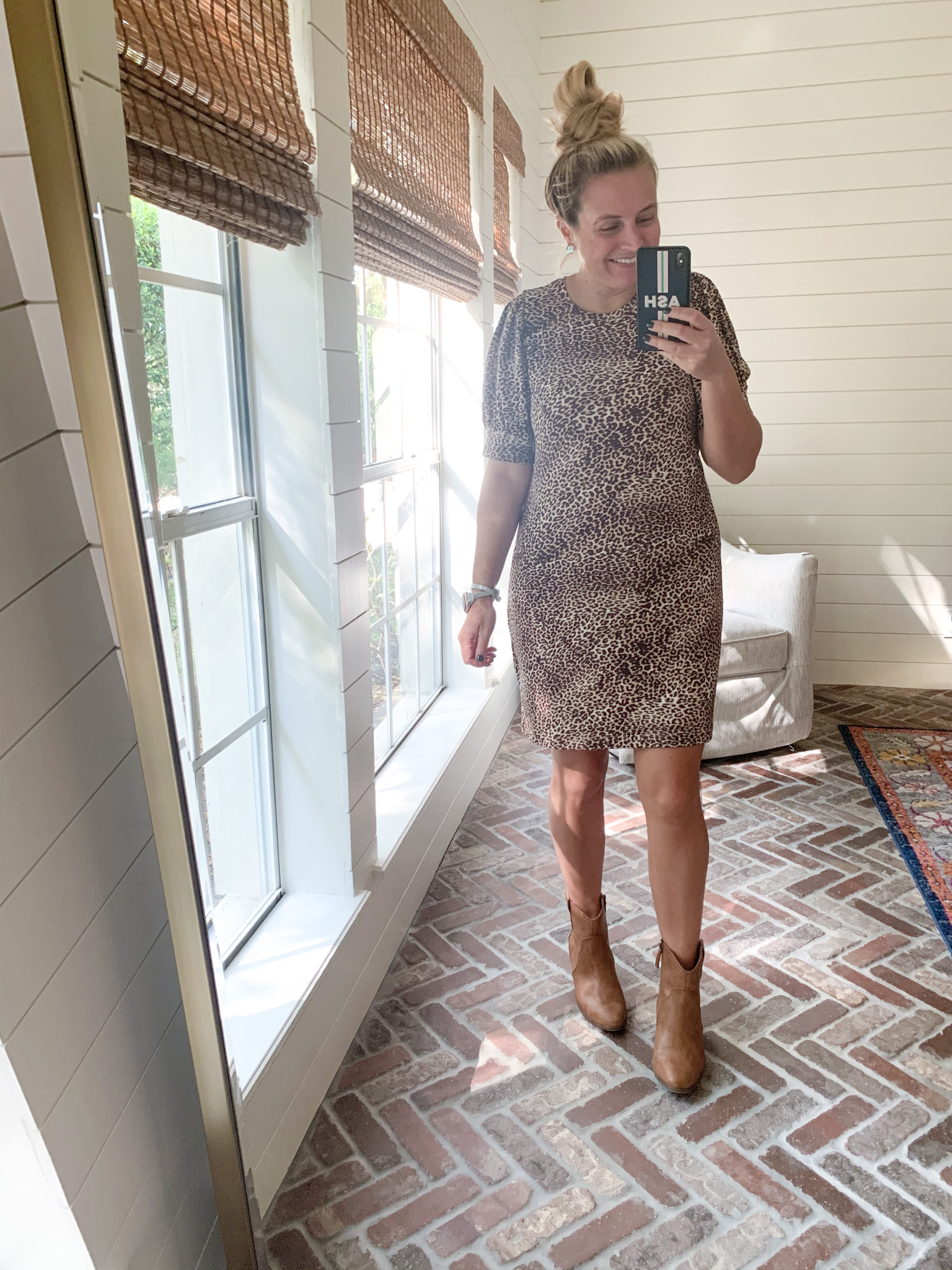 Amazon Haul by popular Houston fashion blog, Fancy Ashley: image of a woman wearing a Amazon Daily Ritual Leopard print puff sleeve dress and Walmart Scoop Women's Willow Western Booties.
