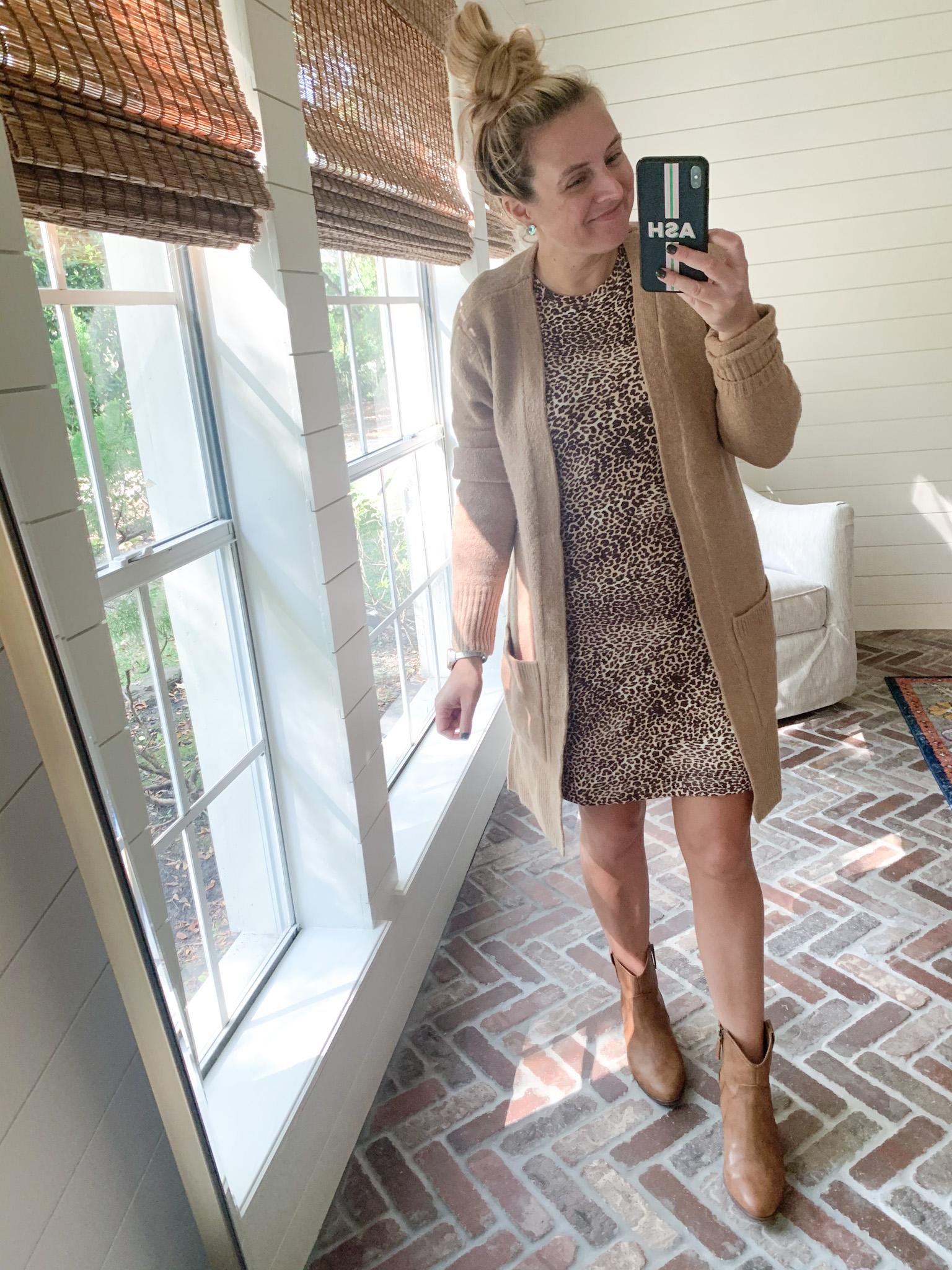 Amazon Haul by popular Houston fashion blog, Fancy Ashley: image of a woman wearing a Amazon Daily Ritual Leopard print puff sleeve dress, Walmart Scoop Women's Willow Western Booties, and Amazon Goodthreads Women's Boucle Cardigan Sweater.