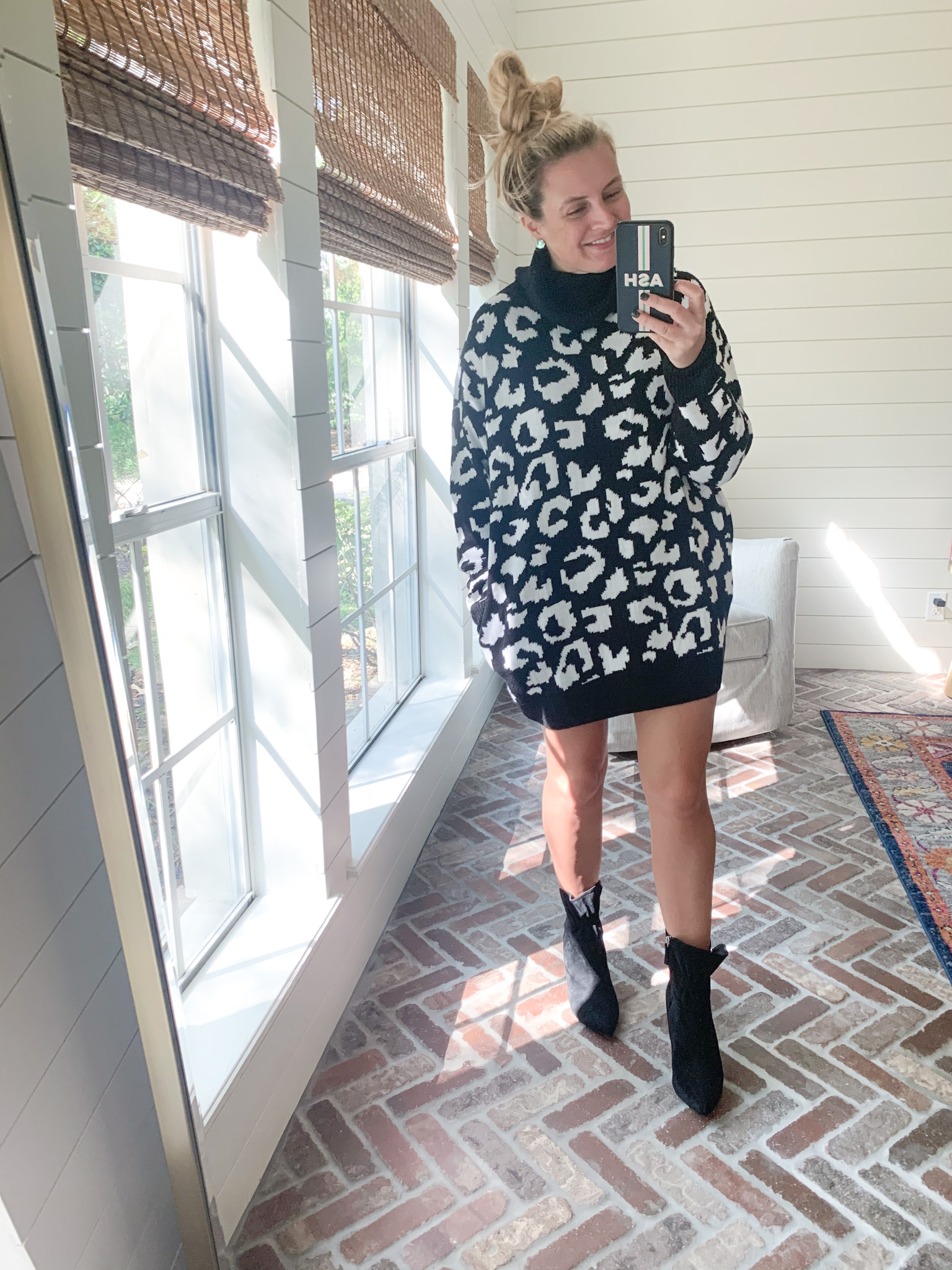 Amazon Haul by popular Houston fashion blog, Fancy Ashley: image of a woman wearing a Amazon Pink Queen Women's Loose Oversize Turtleneck Wool Long Pullover Sweater Dress and Walmart Scoop Women's Blair Scrunch Stiletto Heeled Booties
