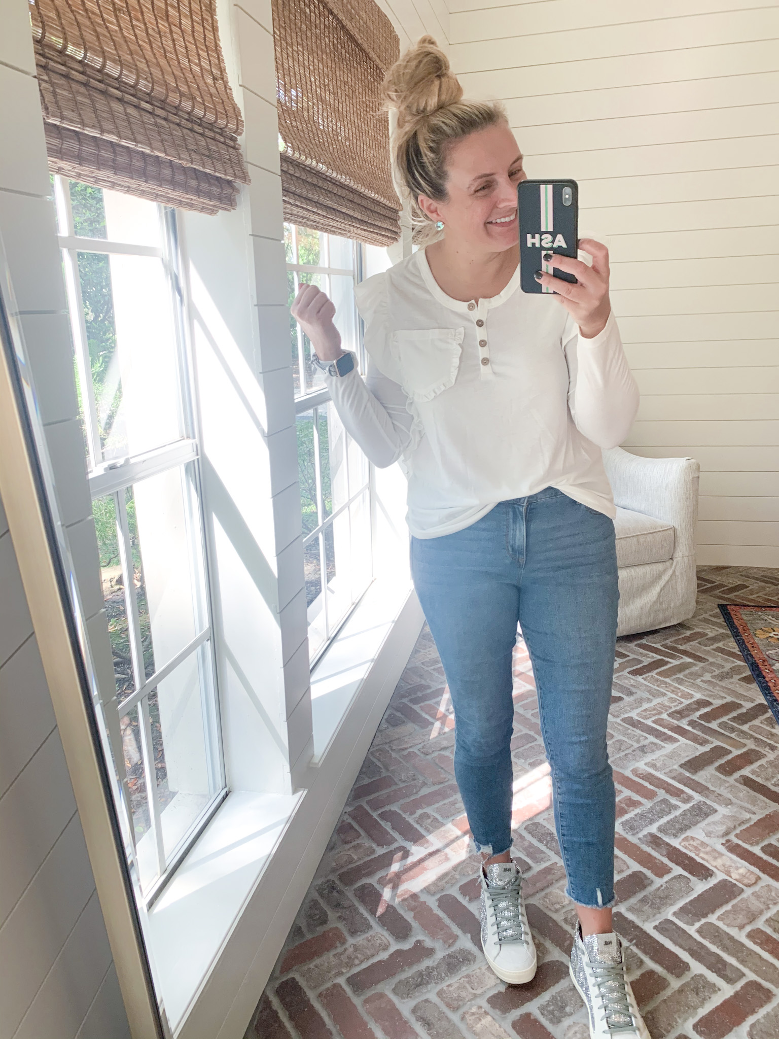 Amazon Haul by popular Houston fashion blog, Fancy Ashley: image of a woman wearing a Amazon GAMISOTE Womens Color Block Long Sleeve T Shirt, Walmart Sofia Jeans Rosa Curvy Ripped Hem High Waist Ankle Jean, and Nordstrom P448 Skate Glitter High Top Sneaker.