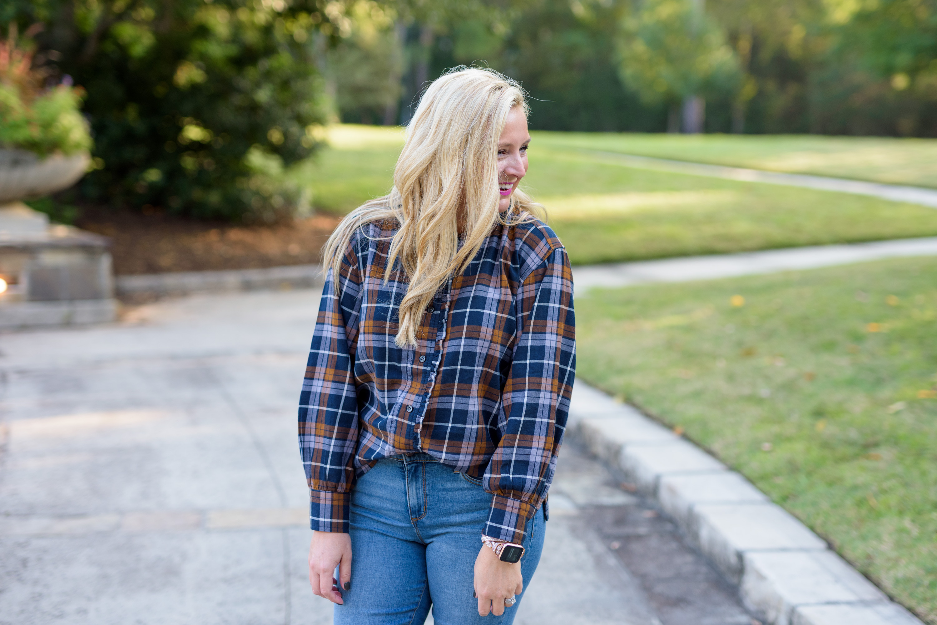 Fall clothing by popular Houston fashion blog, Fancy Ashley: image of a woman wearing a Walmart Free Assembly Women's Micro Ruffled Top, Walmart Sofia Jeans Rosa Curvy Ripped Hem High Waist Ankle Jean, and Walmart Scoop Women's Willow Western Booties.