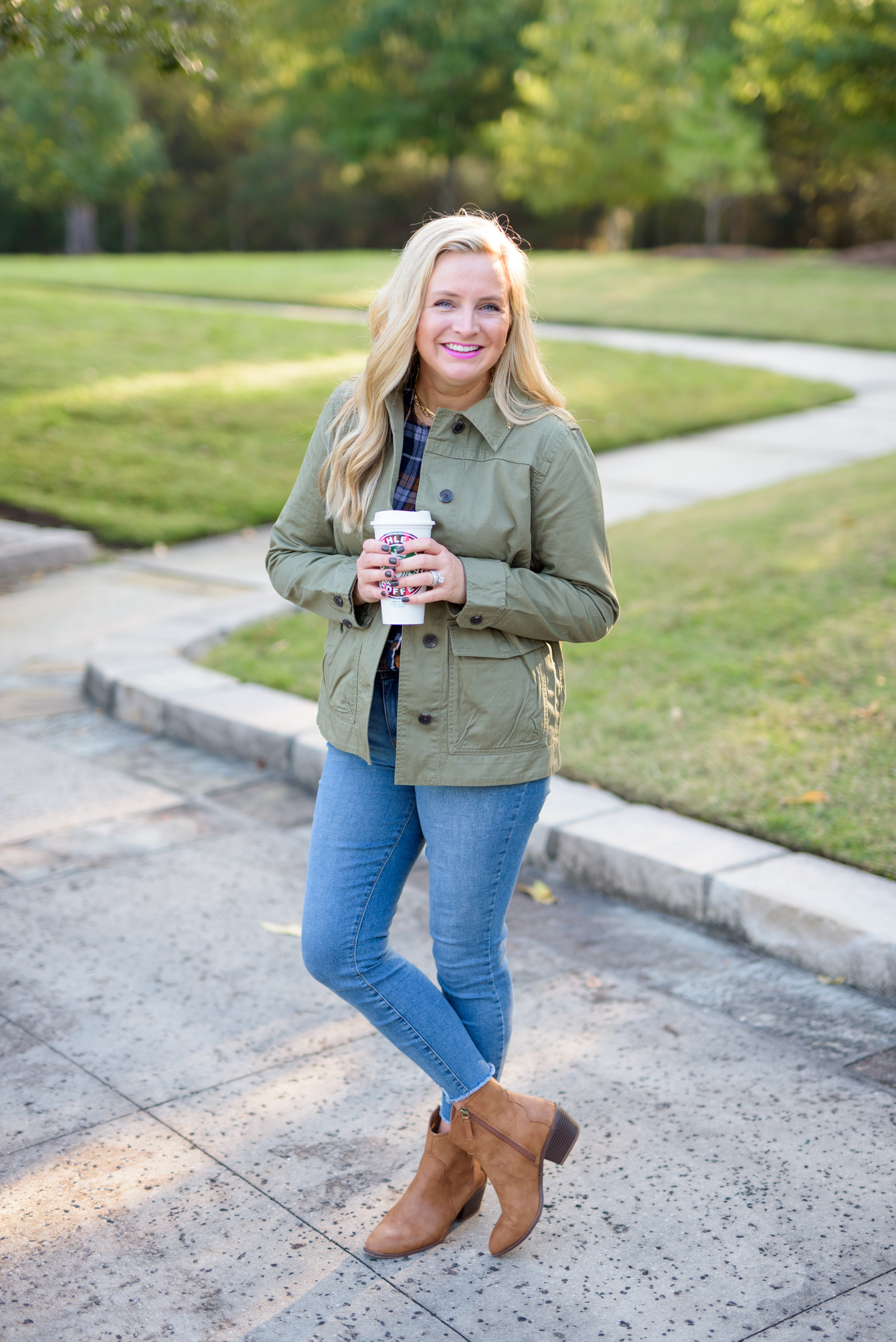 Fall clothing by popular Houston fashion blog, Fancy Ashley: image of a woman wearing a Walmart Free Assembly Women's Micro Ruffled Top, Walmart Free Assembly Women's Fatigue Jacket with Cinching, Walmart Sofia Jeans Rosa Curvy Ripped Hem High Waist Ankle Jean, and Walmart Scoop Women's Willow Western Booties.