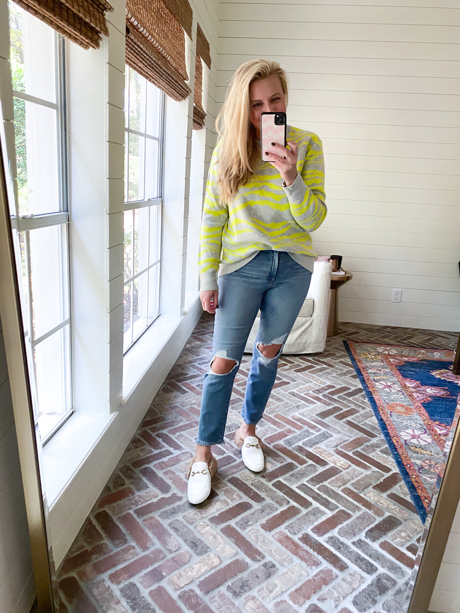 Prime Day by popular Houston fashion blog, Fancy Ashley: image of a woman wearing a Amazon sweater, distressed denim, and white mules.