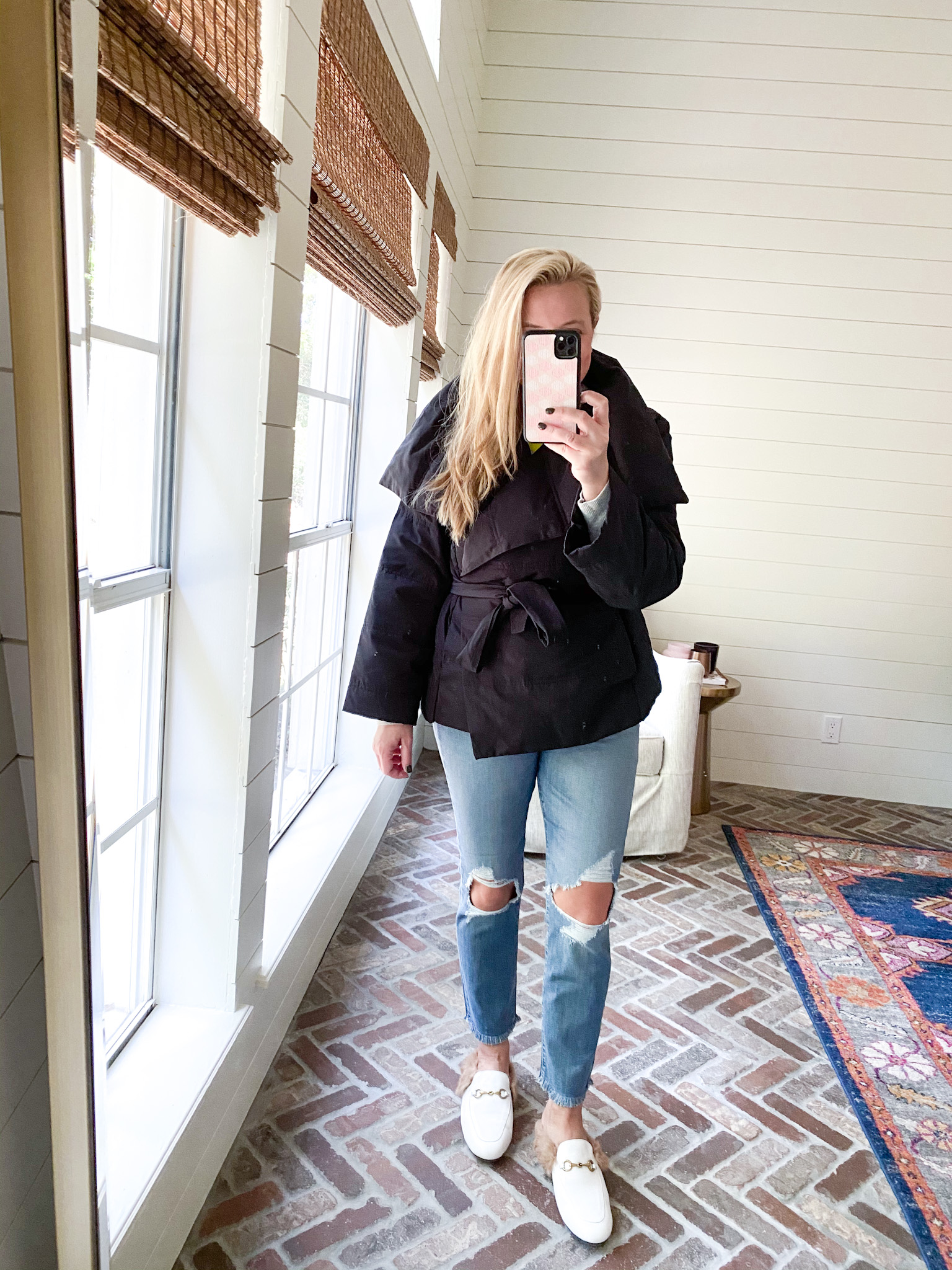 Prime Day by popular Houston fashion blog, Fancy Ashley: image of a woman wearing a Amazon coat, distressed denim, and white mules.