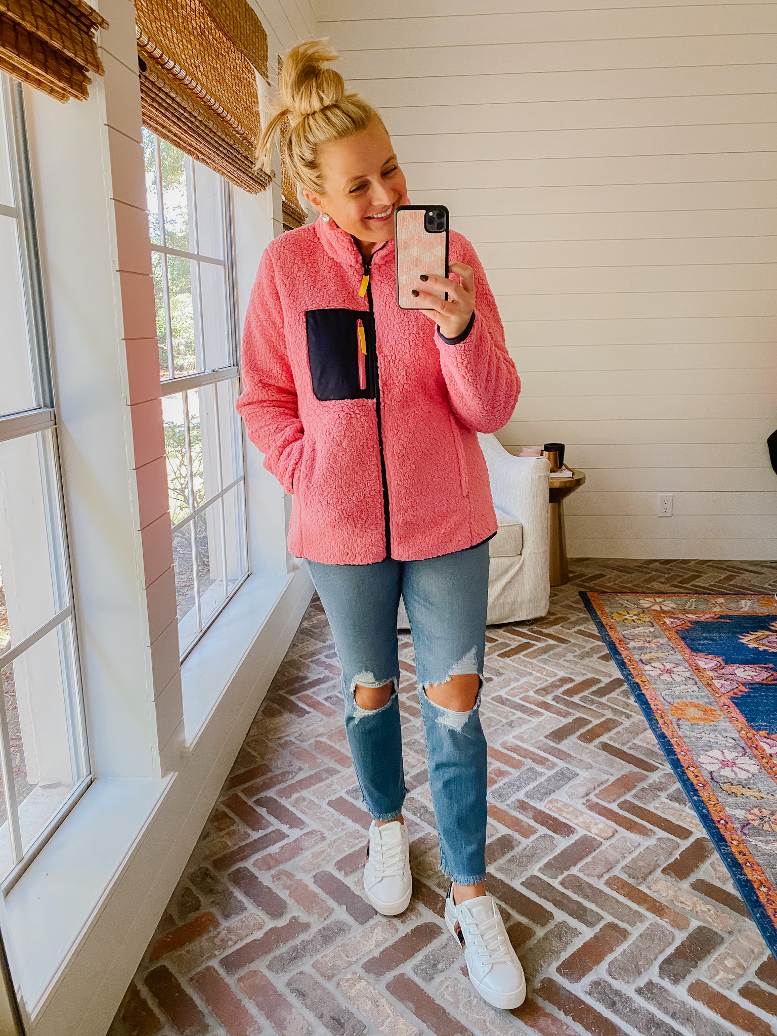 Cute Fall Outfits by popular Houston fashion blog, Fancy Ashley: image of a woman wearing a wubby fleece jacket, distressed jeans and a pair of white sneakers.