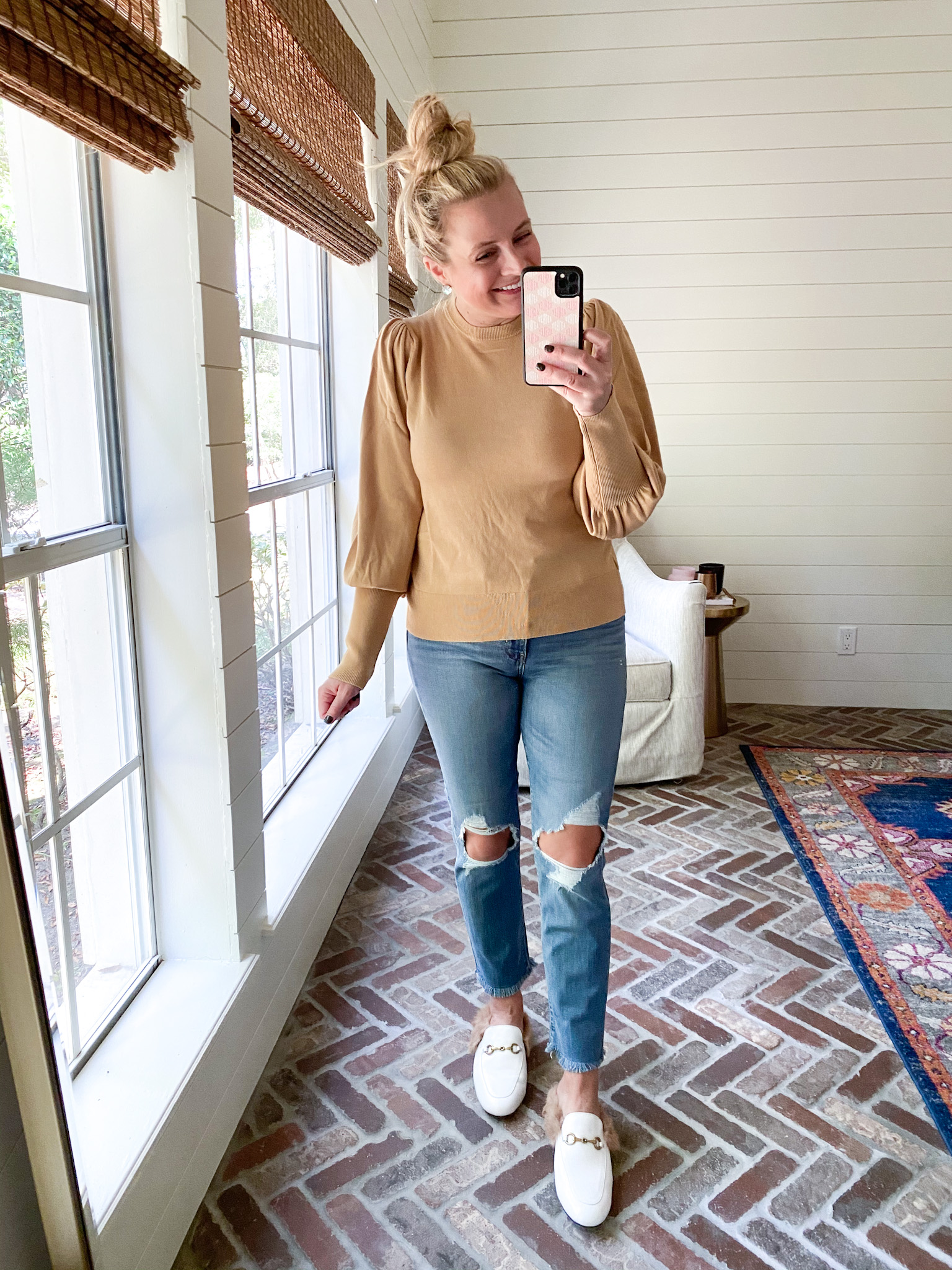 Prime Day by popular Houston fashion blog, Fancy Ashley: image of a woman wearing a Amazon puff sleeve top, distressed denim, and white mules.