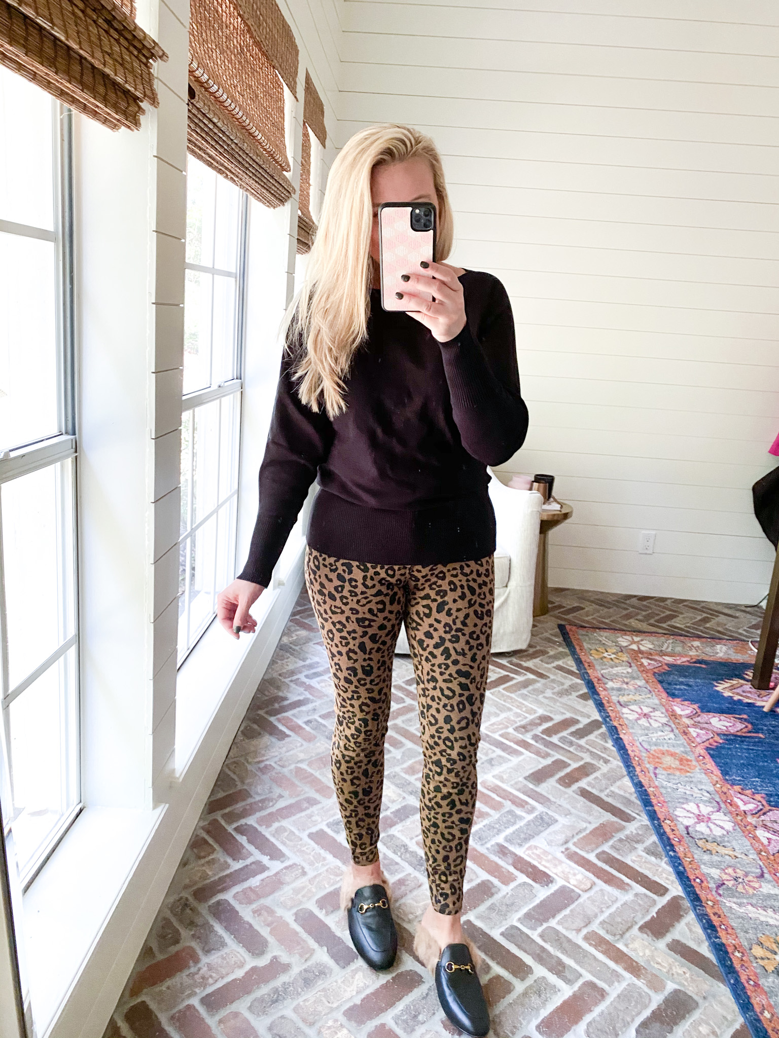 Prime Day by popular Houston fashion blog, Fancy Ashley: image of a woman wearing a Amazon black sweater, leopard print pants, and black mules.