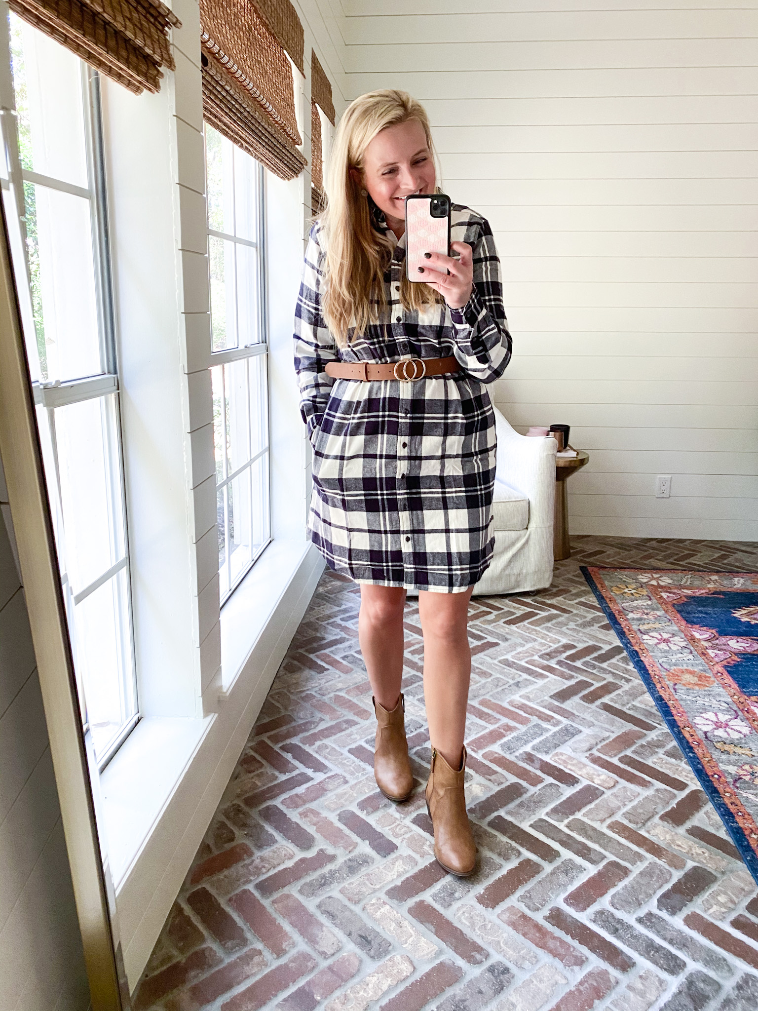 Prime Day by popular Houston fashion blog, Fancy Ashley: image of a woman wearing a Amazon plaid dress, brown belt, and tan ankle boots.