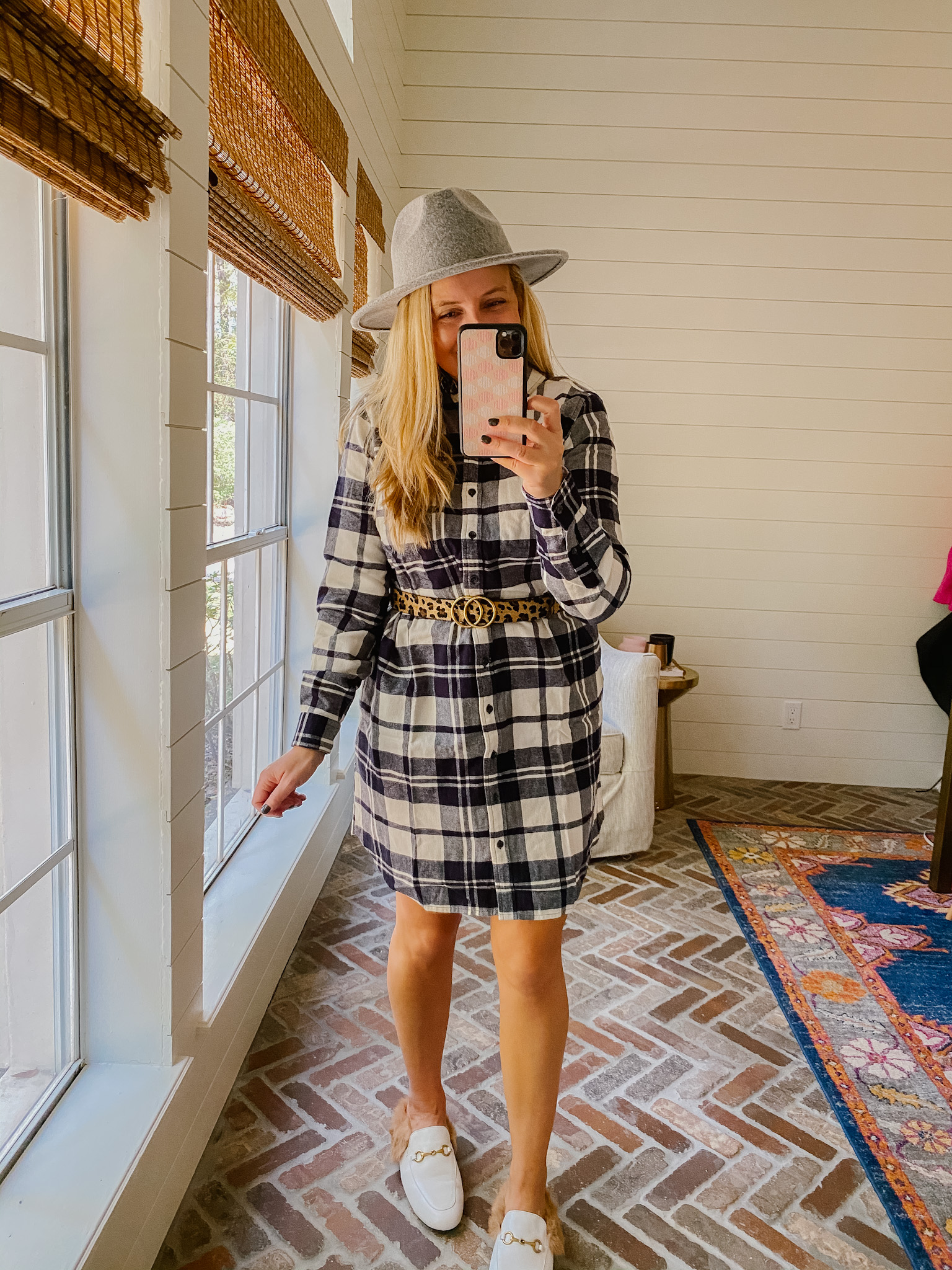 Prime Day by popular Houston fashion blog, Fancy Ashley: image of a woman wearing a Amazon plaid dress, felt hat, leopard print belt and white mules.
