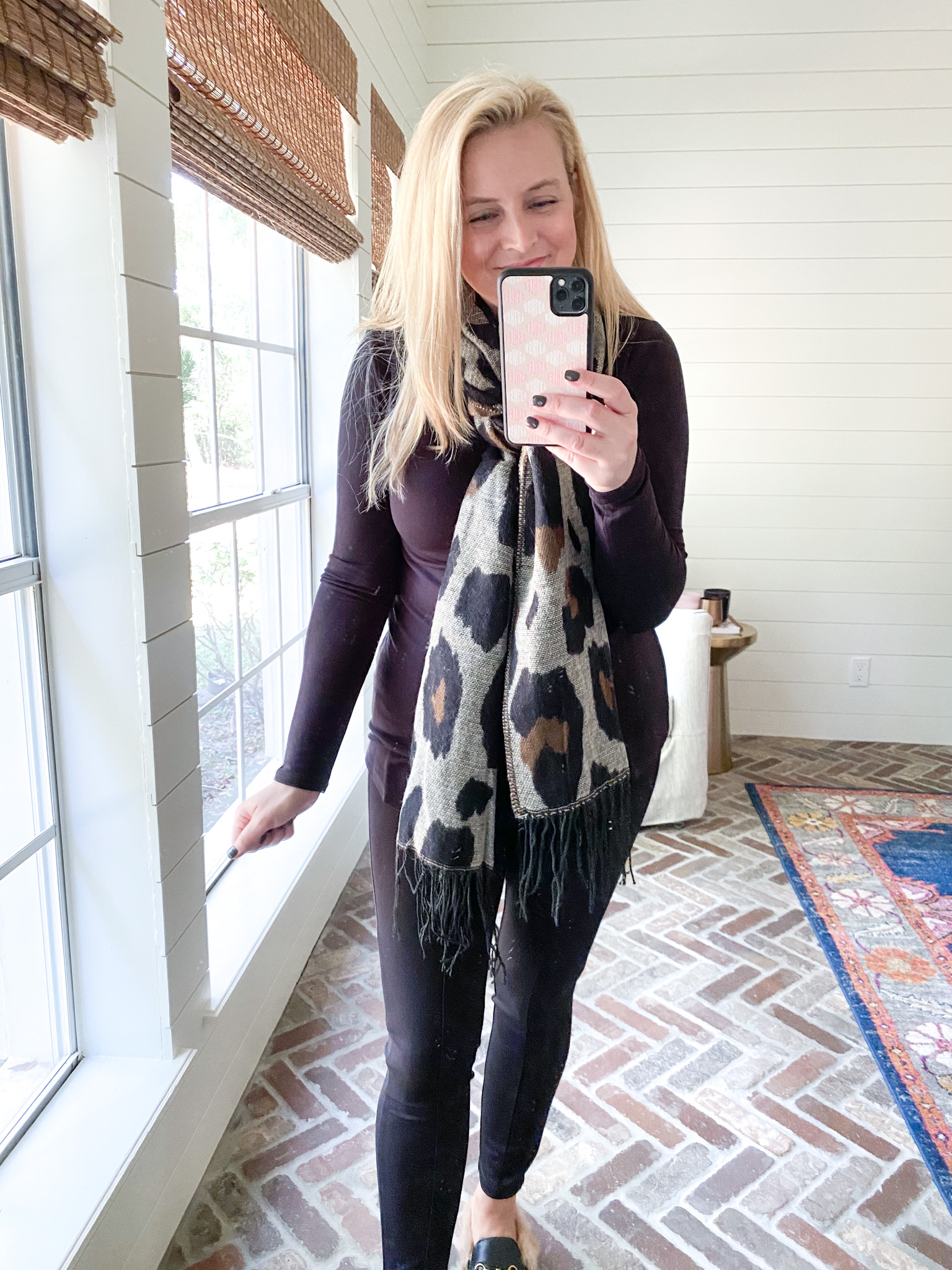 Prime Day by popular Houston fashion blog, Fancy Ashley: image of a woman wearing a Amazon leopard print scar, black long sleeve t-shirt, black legging, and black mules.