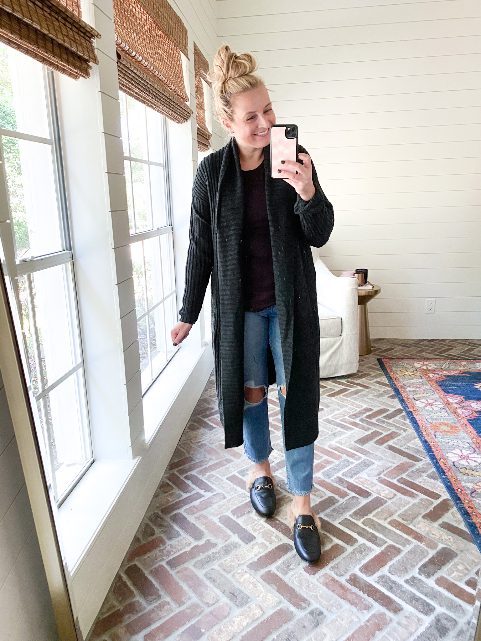 Prime Day by popular Houston fashion blog, Fancy Ashley: image of a woman wearing a Amazon black longline cardigan, distressed jeans, and black mules.