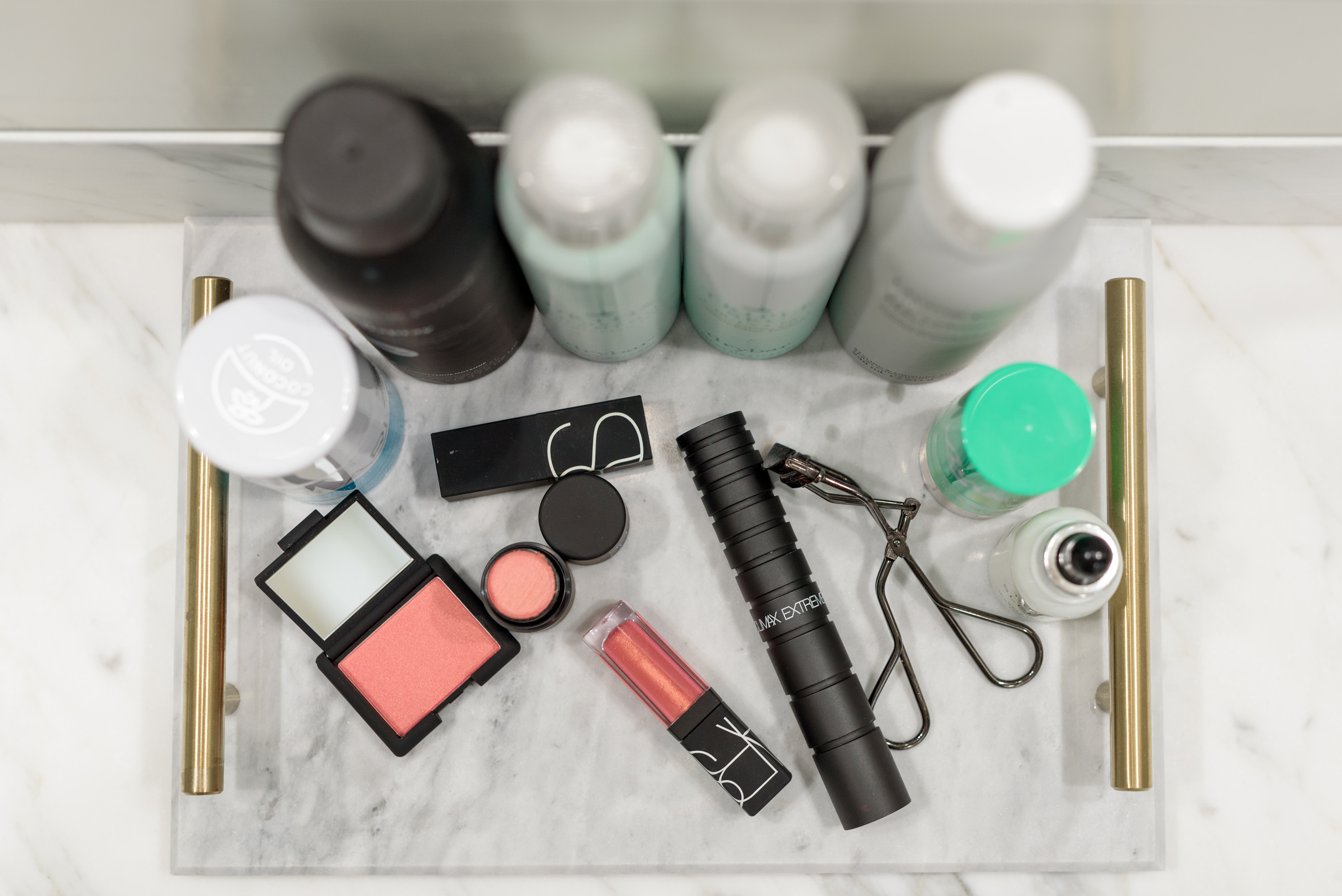 Fall Beauty by popular Houston beauty blog, Fancy Ashley: image of Living Proof flex hairspray, Living Proof dry shampoo, blush, Nars lipgloss, eyelash curler, Dry Bar Detox dry shampoo, Drybar Triple Sec, Tan-Luxe sleep oil,CLEAN BEAUTY POWDER SPF, and NARS CLIMAX EXTREME MASCARA.