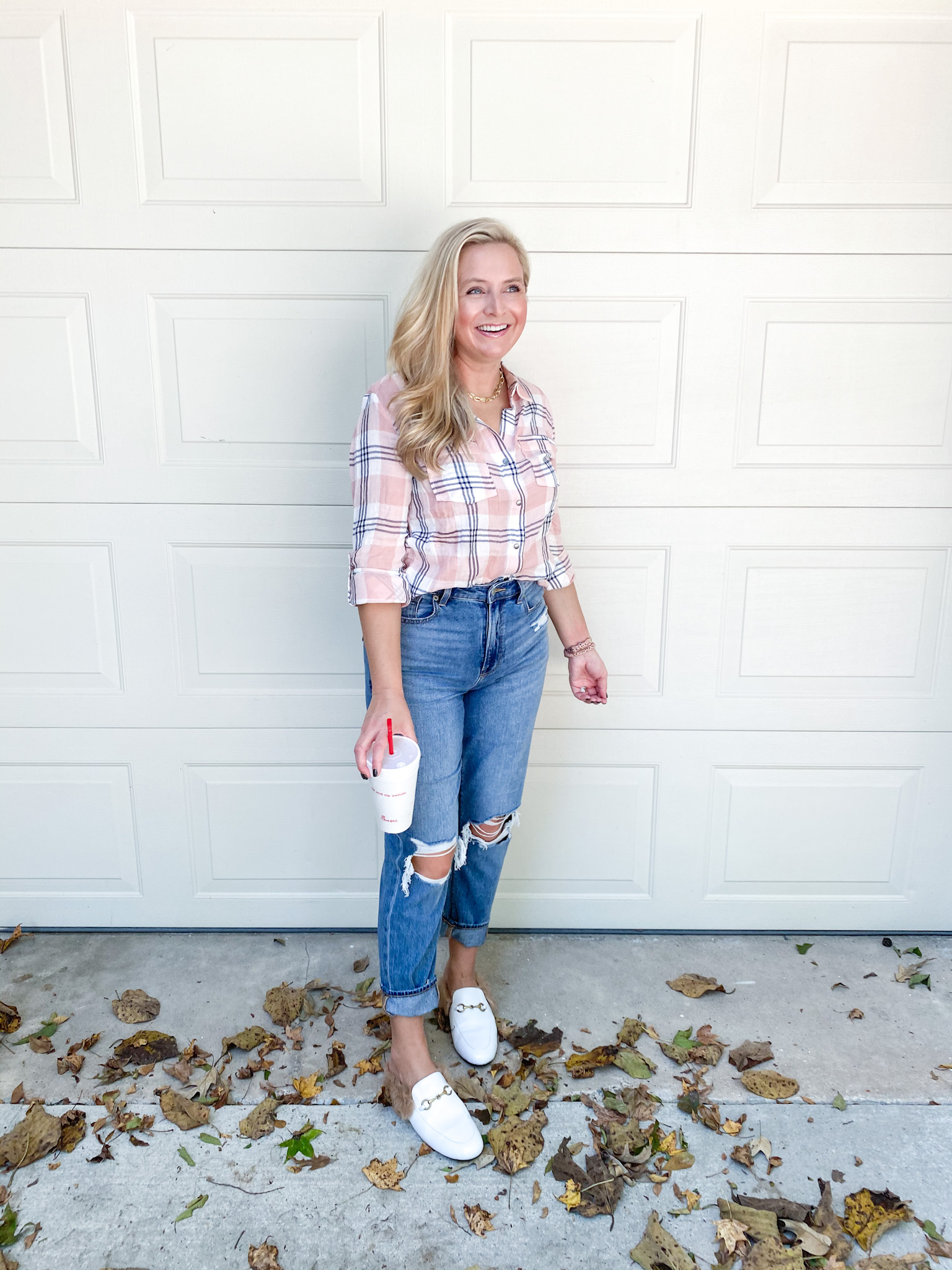 Fall Plaid by popular Houston fashion blog, Fancy Ashley: image of a woman wearing a plaid top, distressed jeans, and white faux fur lined mules.