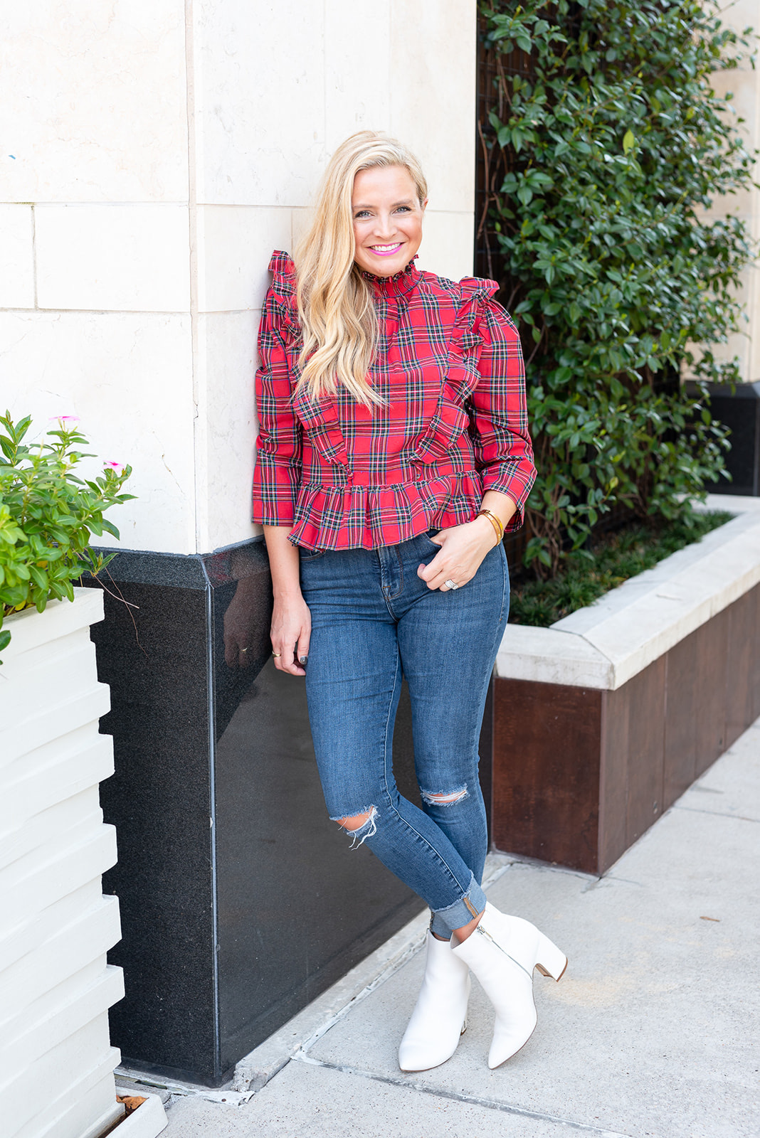 Fall Plaid by popular Houston fashion blog, Fancy Ashley: image of a woman wearing a a red ruffle plaid top, jeans, and white ankle boots.