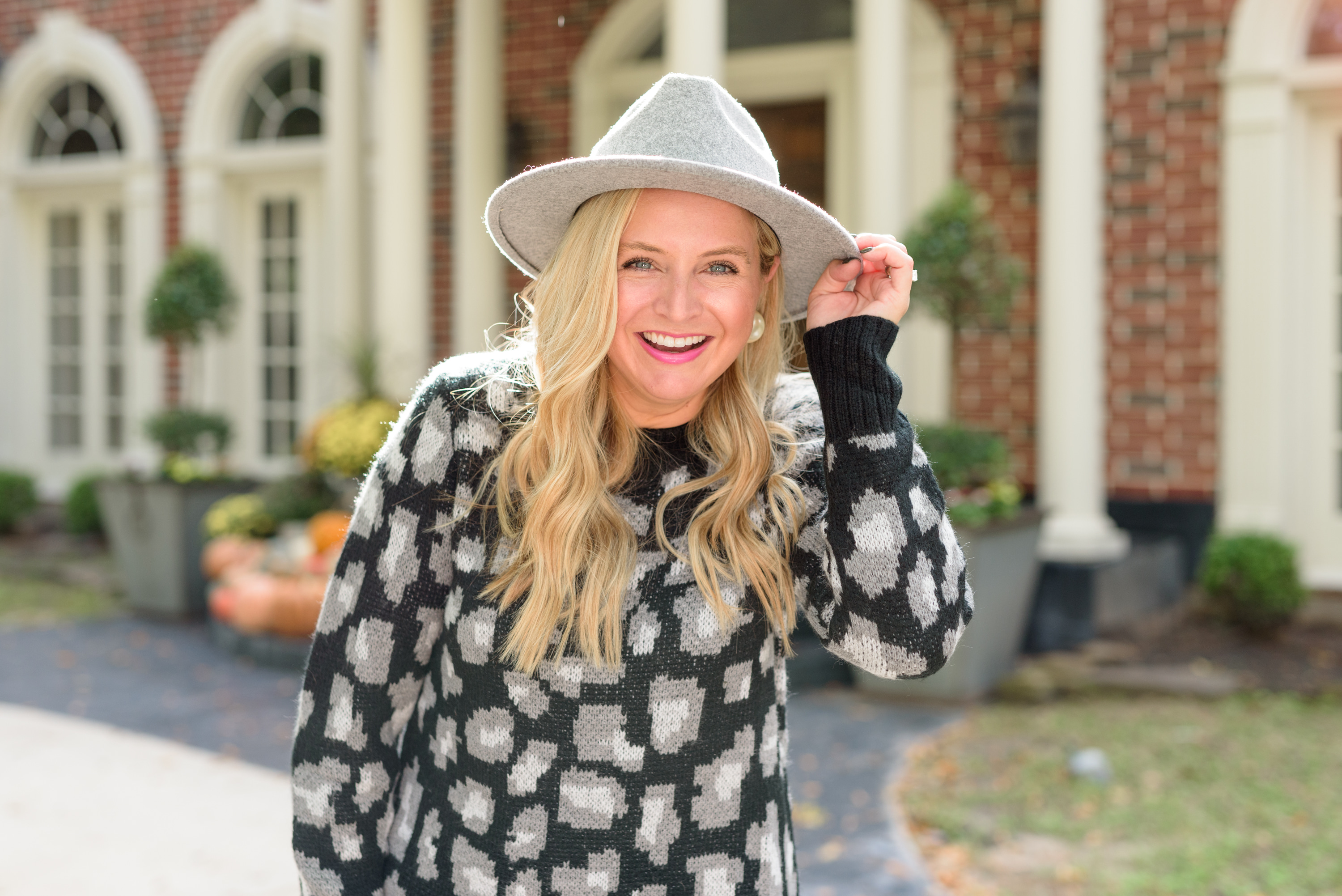 Fall Clothing by popular Houston fashion blog, Fancy Ashley: image of a woman wearing a Walmart Scoop Women's Leopard Print Sweater Dress, Walmart Scoop Alexandra Women's Over the Knee Heeled Boots, and Walmart Time and Tru Women's Chenille Fedora with Braided Trim.