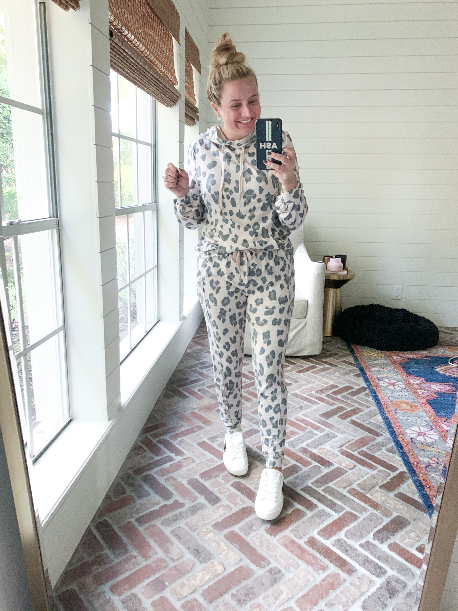 Fall Clothing by popular Houston fashion blog, Fancy Ashley: image of a woman wearing a Walmart Scoop Women's Animal Printed Joggers with Front Seaming, Walmart Scoop Women's Leopard Print French Terry Hoodie, and a pair of Walmart Time and Tru Women's Fashion Sneakers.