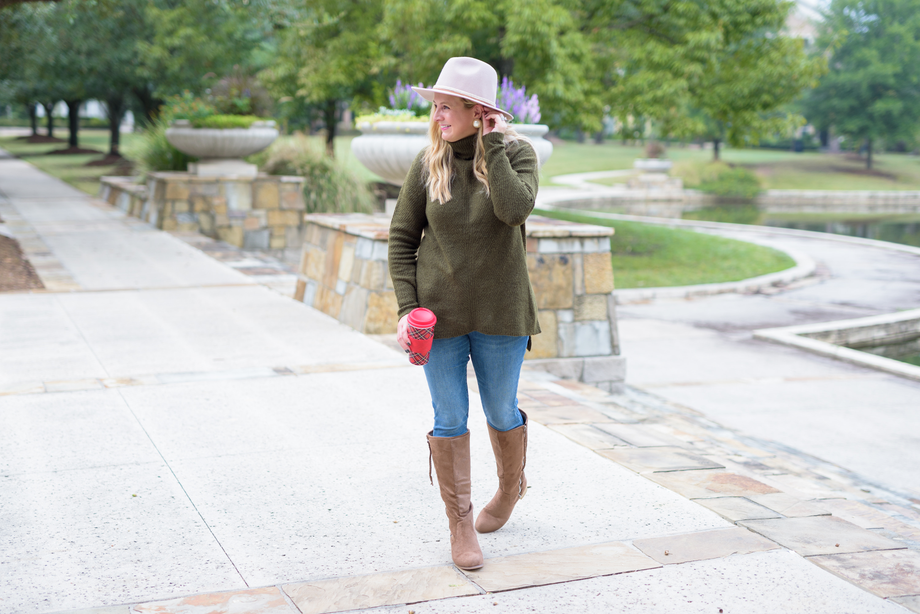 Knee High Boots by popular Houston fashion blog, Fancy Ashley: image of a woman standing outside and wearing a Nordstrom Rack Sweet Romeo Abstract Rib Turtleneck Tunic, Nordstrom Rack KUT from the Kloth Carlo Raw Crop Hem Skinny Jeans, Nordstrom Rack JOURNEE Collection Sanora Knee High Boot, and Nordstrom Rack Frye Braided Crown Felted Fedora Hat.