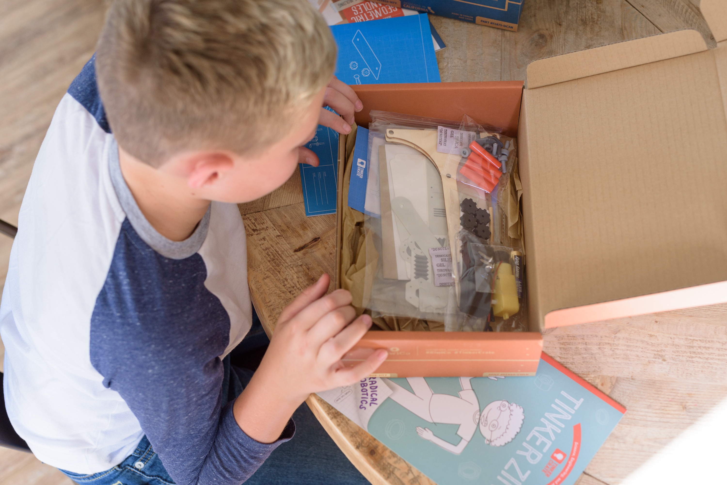 Kiwico Reviews by popular Houston lifestyle blog, Fancy Ashley: image of a boy looking through his Kiwico box.