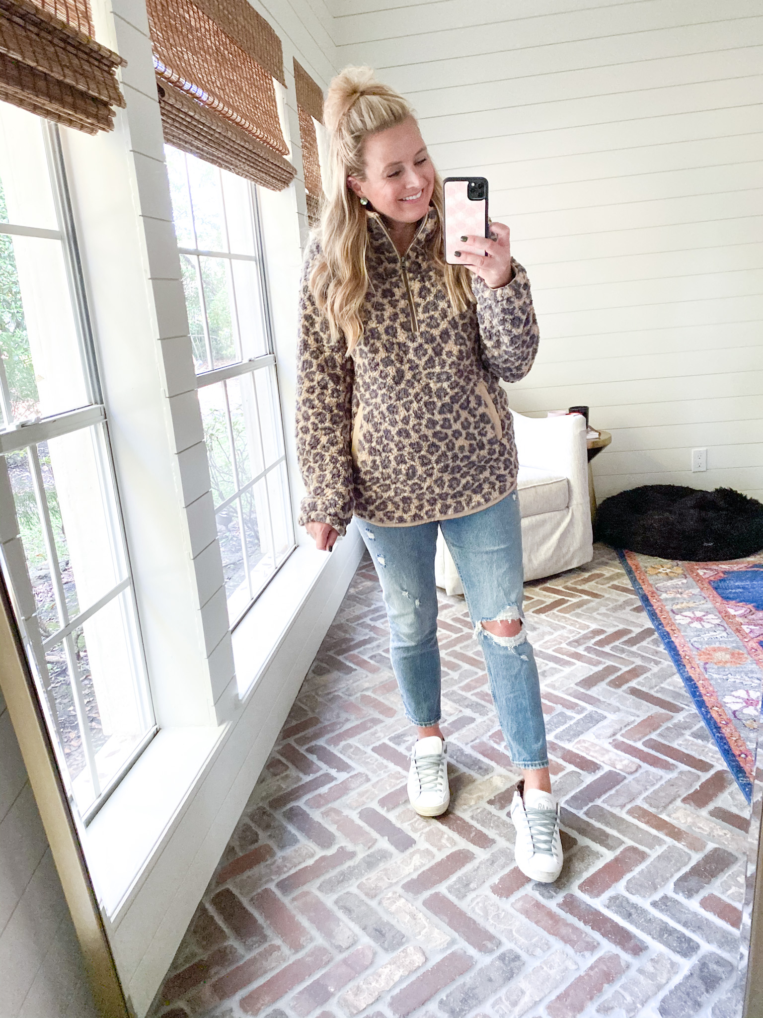 Cute Fall Outfits by popular Houston fashion blog, Fancy Ashley: image of a woman wearing a leopard print wubby fleece pullover, distressed jeans, and white sneakers.